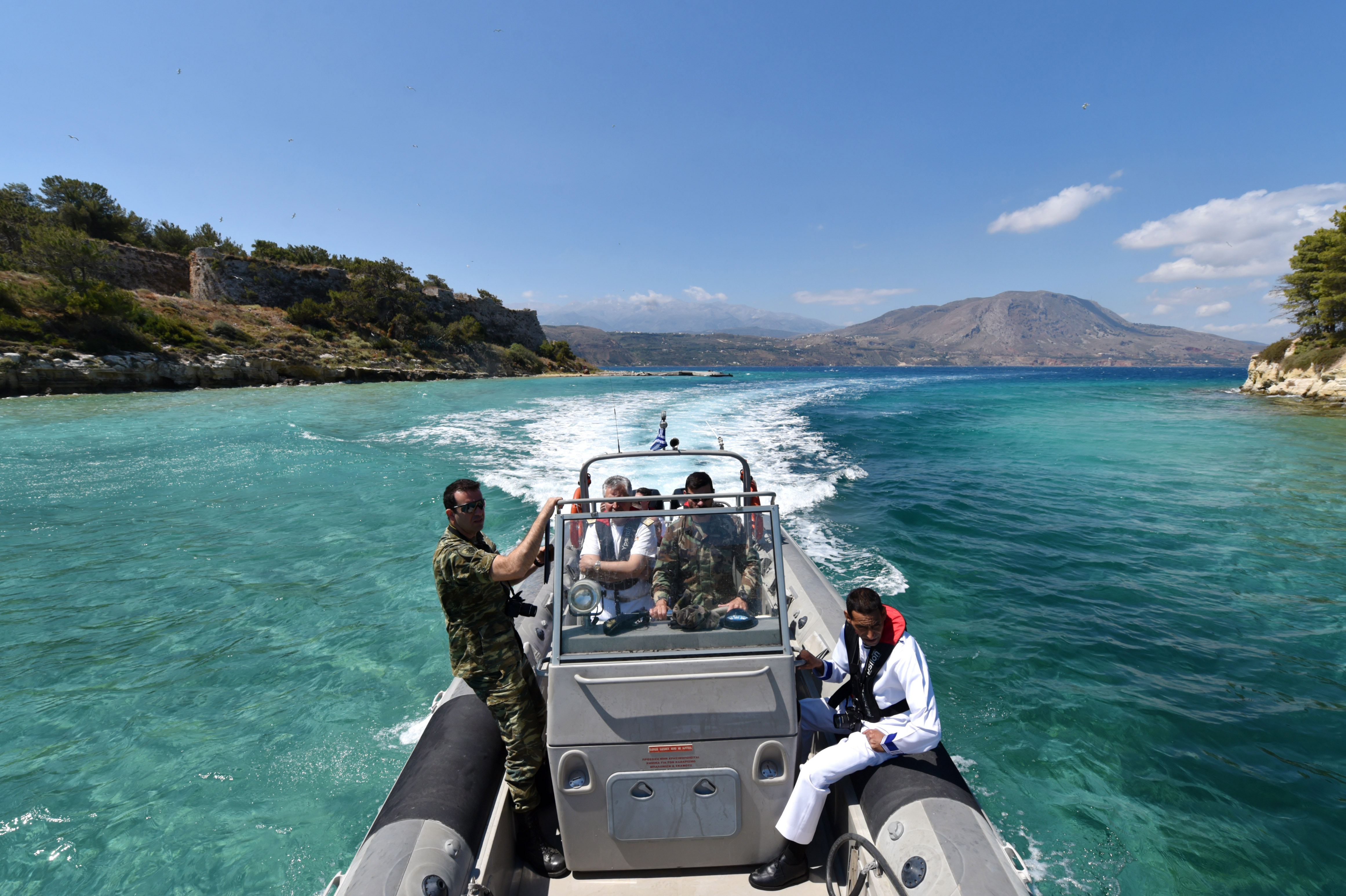 160517-N-XT273-320 SOUDA BAY, Greece (May 17, 2016) Maritime professionals from North Africa, Europe and the U.S. take a tour of Naval Support Activity Souda Bay on a Hellenic rigid hull inflatable boat after the Exercise Phoenix Express 2016 opening ceremony May 17. Phoenix Express 2016, sponsored and facilitated by U.S Africa Command, is designed to improve regional cooperation, increase maritime domain awareness, information-sharing practices, and operational capabilities to enhance efforts to achieve safety and security in the Mediterranean Sea. (U.S. Navy photo by Mass Communication Specialist 2nd Class Justin Stumberg/Released)