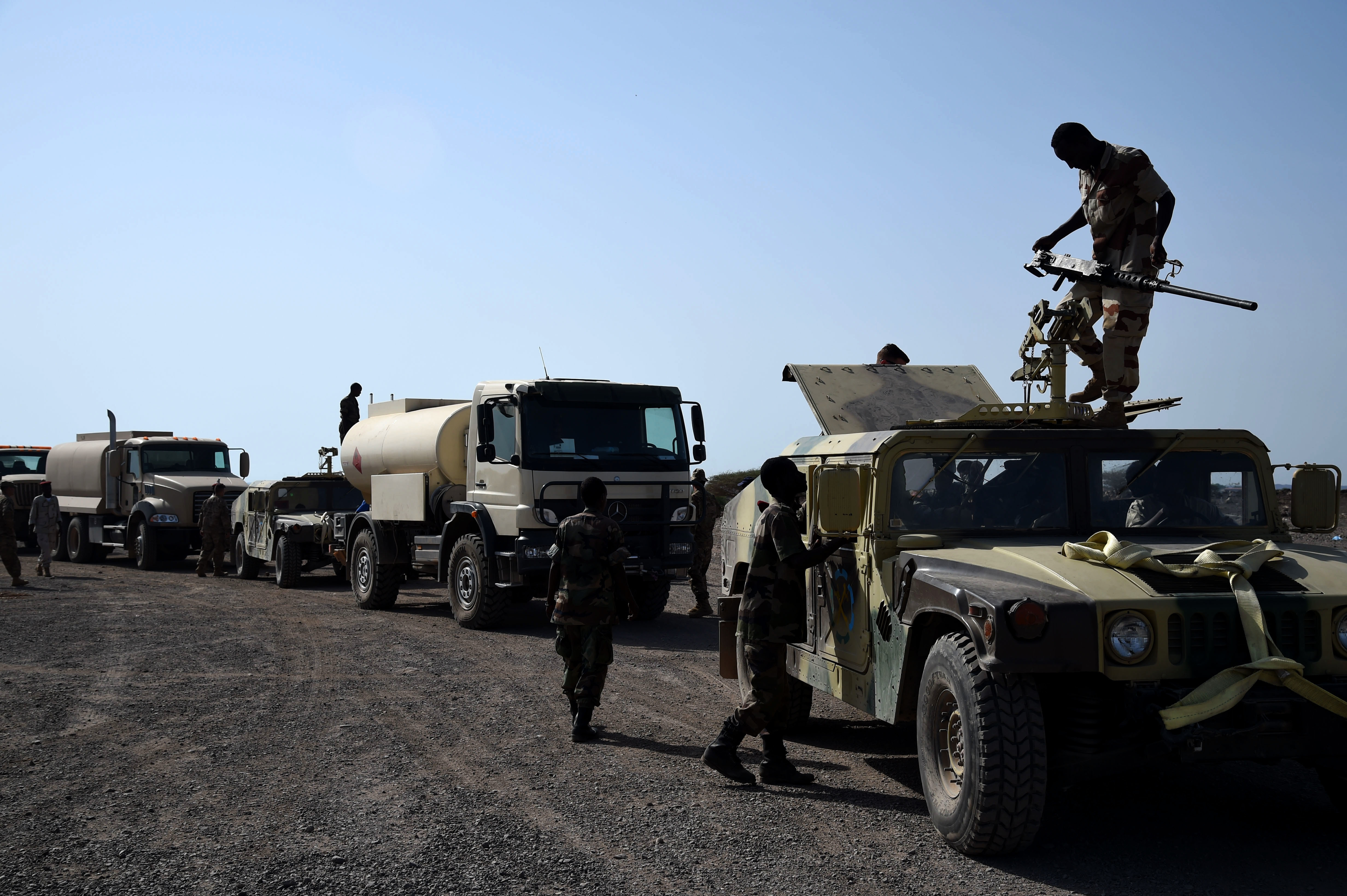 CAMP CHEIK OSMAN, Djibouti – Djiboutian Armed Forces (FAD) Soldiers prepare their convoy for the final test after completing a five-month training course instructed by the U.S. Army Regionally Aligned Forces Soldiers, May 16, 2016, at Camp Cheik Osman, Djibouti. The three-phased training was completed demonstrating their reactions to various mock situations from convoying through a road block, identifying mock roadside bombs, medical care, and vehicle recovery. (U.S. Air Force photo by Staff Sgt. Tiffany DeNault/Released)