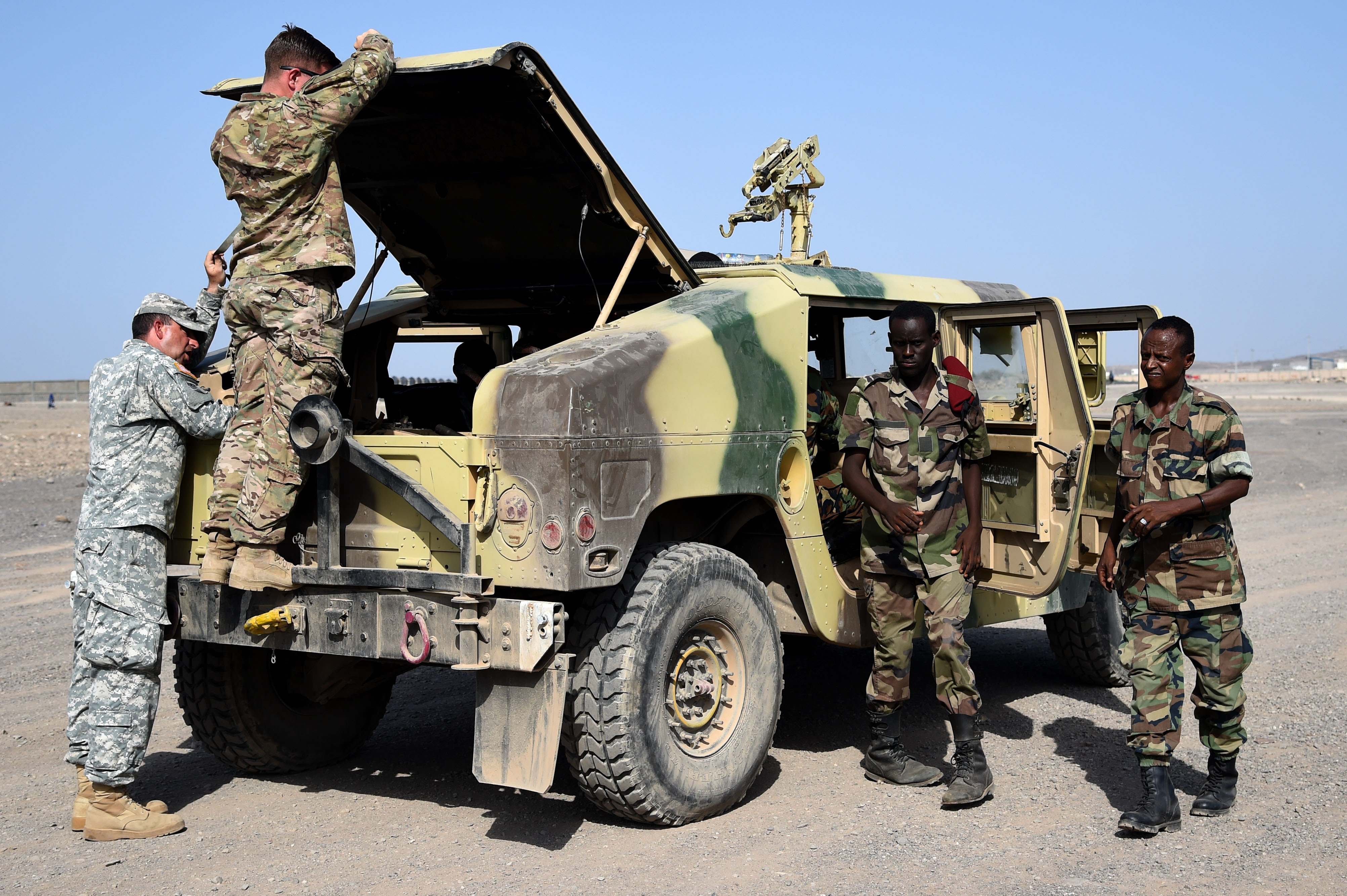 CAMP CHEIK OSMAN, Djibouti – Djiboutian Armed Forces (FAD) Soldiers prepare their Humvee for the final test after completing a five-month training course instructed by the U.S. Army Regionally Aligned Forces Soldiers, May 16, 2016, at Camp Cheik Osman, Djibouti. The FAD soldiers tested the skills they learned by demonstrating their reactions to various mock situations from convoying through a road block, identifying mock roadside bombs, medical care, and vehicle recovery. (U.S. Air Force photo by Staff Sgt. Tiffany DeNault/Released)