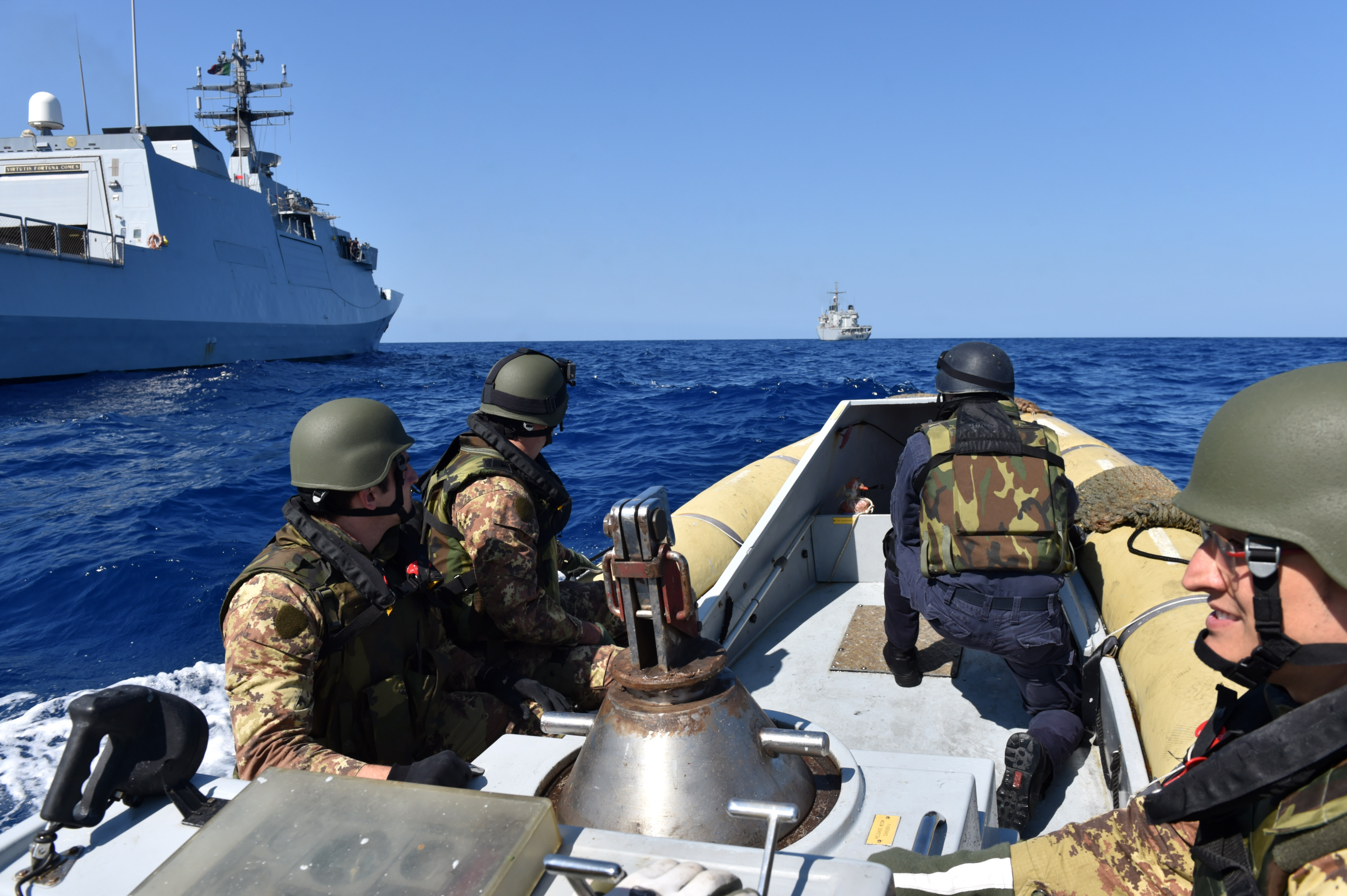 160525-N-XT273-217 MEDITERRANEAN SEA (May 25, 2016) Italian sailors and marines participate in a mock visit, board, search, and seizure boarding drill aboard the Royal Moroccan ship P611 during exercise Phoenix Express 2016, May 25. Phoenix Express is a U.S. Africa Command-sponsored multinational maritime exercise designed to increase maritime safety and security in the Mediterranean. (U.S. Navy photo by Mass Communication Specialist 2nd Class Justin Stumberg/Released)
