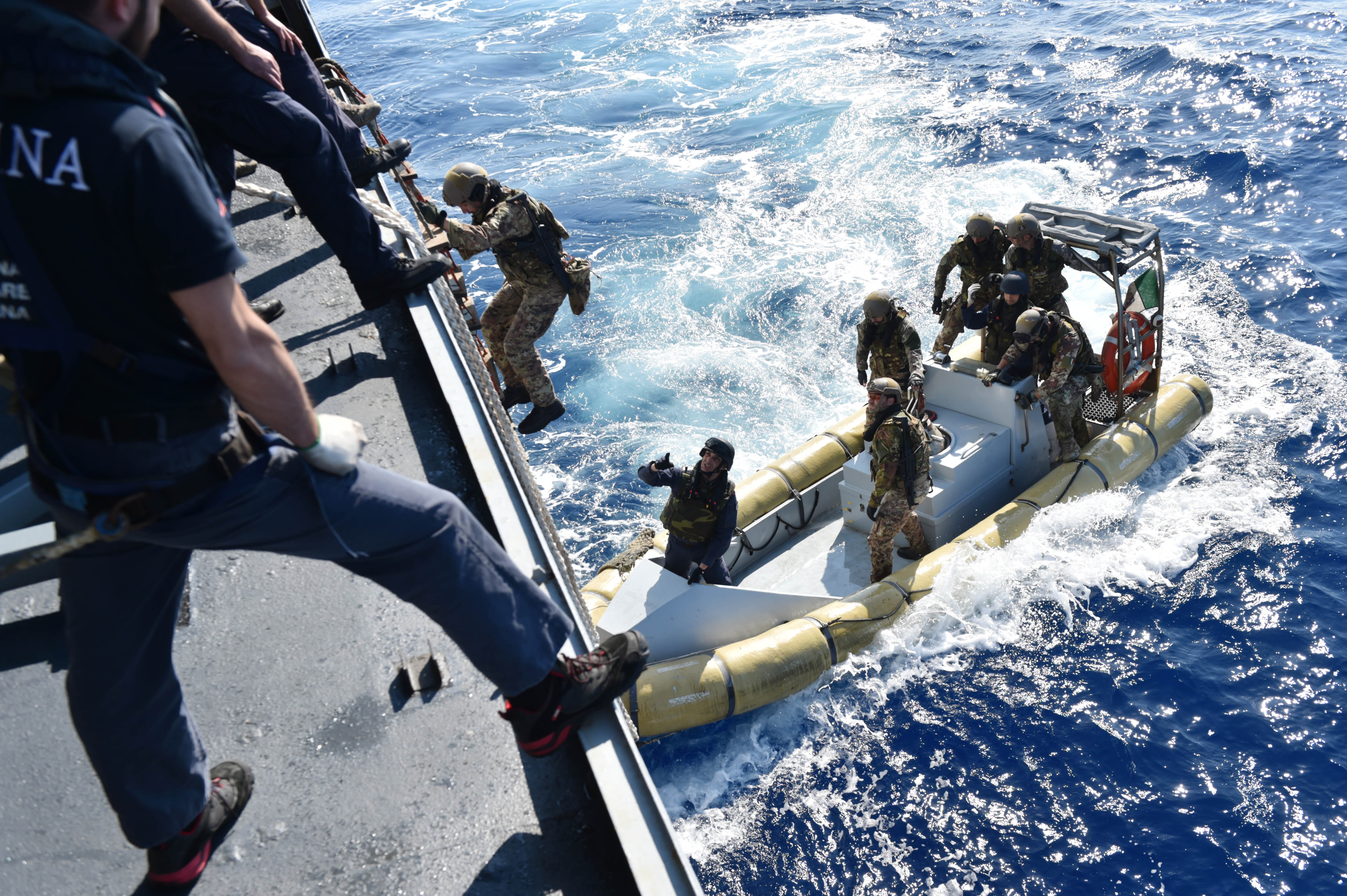 160525-N-XT273-136 MEDITERRANEAN SEA (May 25, 2016) Italian sailors and marines participate in a mock visit, board, search, and seizure boarding drill aboard the Royal Moroccan ship P611 during exercise Phoenix Express 2016, May 24. Phoenix Express is a U.S. Africa Command-sponsored multinational maritime exercise designed to increase maritime safety and security in the Mediterranean. (U.S. Navy photo by Mass Communication Specialist 2nd Class Justin Stumberg/Released)