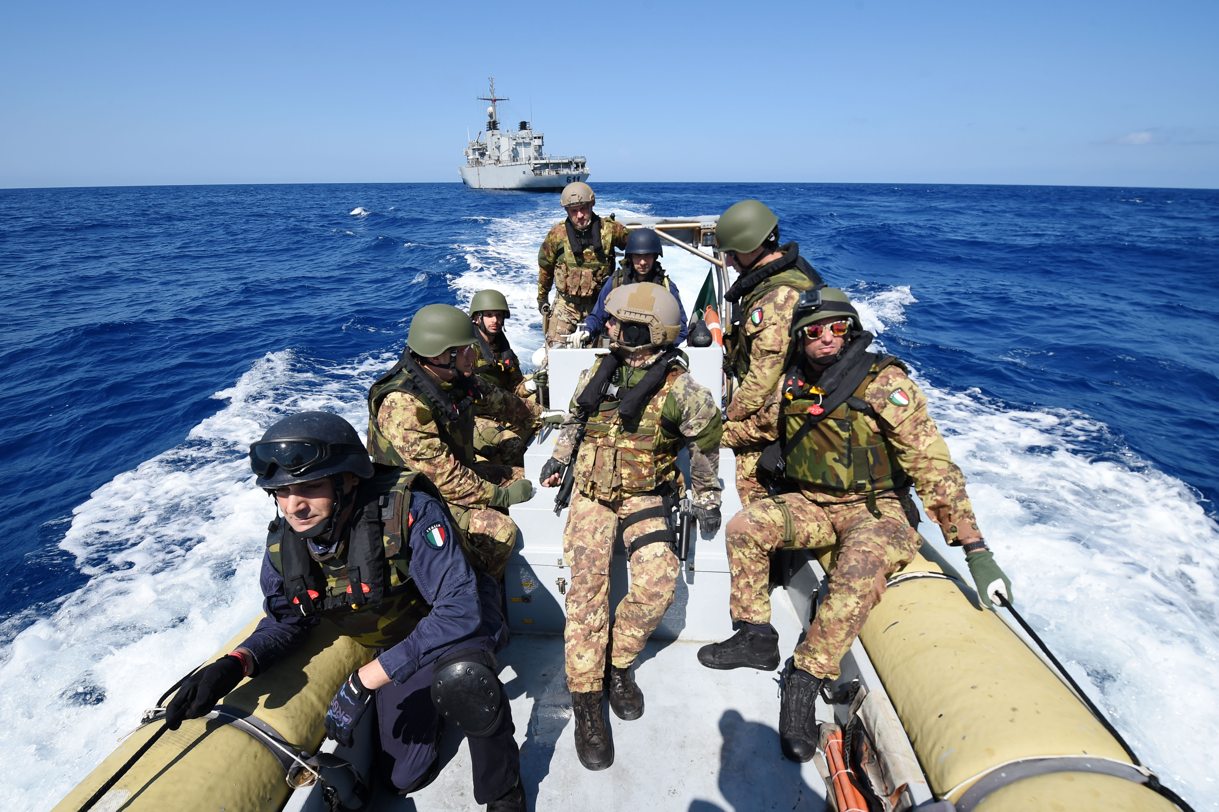 160525-N-XT273-411 MEDITERRANEAN SEA (May 25, 2016) Italian sailors and marines participate in a mock visit, board, search, and seizure boarding drill aboard the Royal Moroccan ship P611 during exercise Phoenix Express 2016, May 25. Phoenix Express is a U.S. Africa Command-sponsored multinational maritime exercise designed to increase maritime safety and security in the Mediterranean. (U.S. Navy photo by Mass Communication Specialist 2nd Class Justin Stumberg/Released)