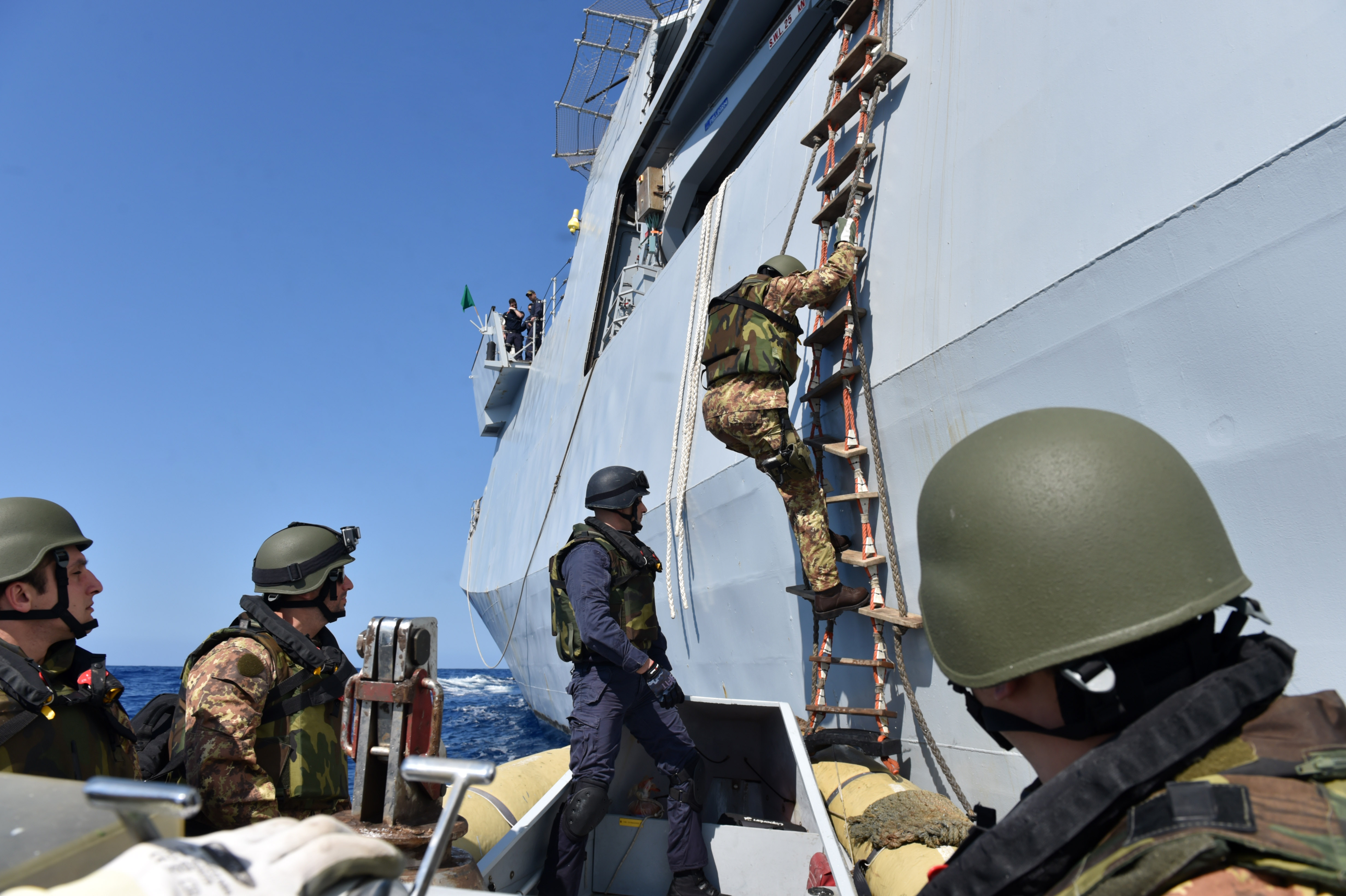 160525-N-XT273-191 MEDITERRANEAN SEA (May 25, 2016) Italian sailors and marines participate in a mock visit, board, search, and seizure boarding drill aboard the Royal Moroccan ship P611 during exercise Phoenix Express 2016, May 25. Phoenix Express is a U.S. Africa Command-sponsored multinational maritime exercise designed to increase maritime safety and security in the Mediterranean. (U.S. Navy photo by Mass Communication Specialist 2nd Class Justin Stumberg/Released)
