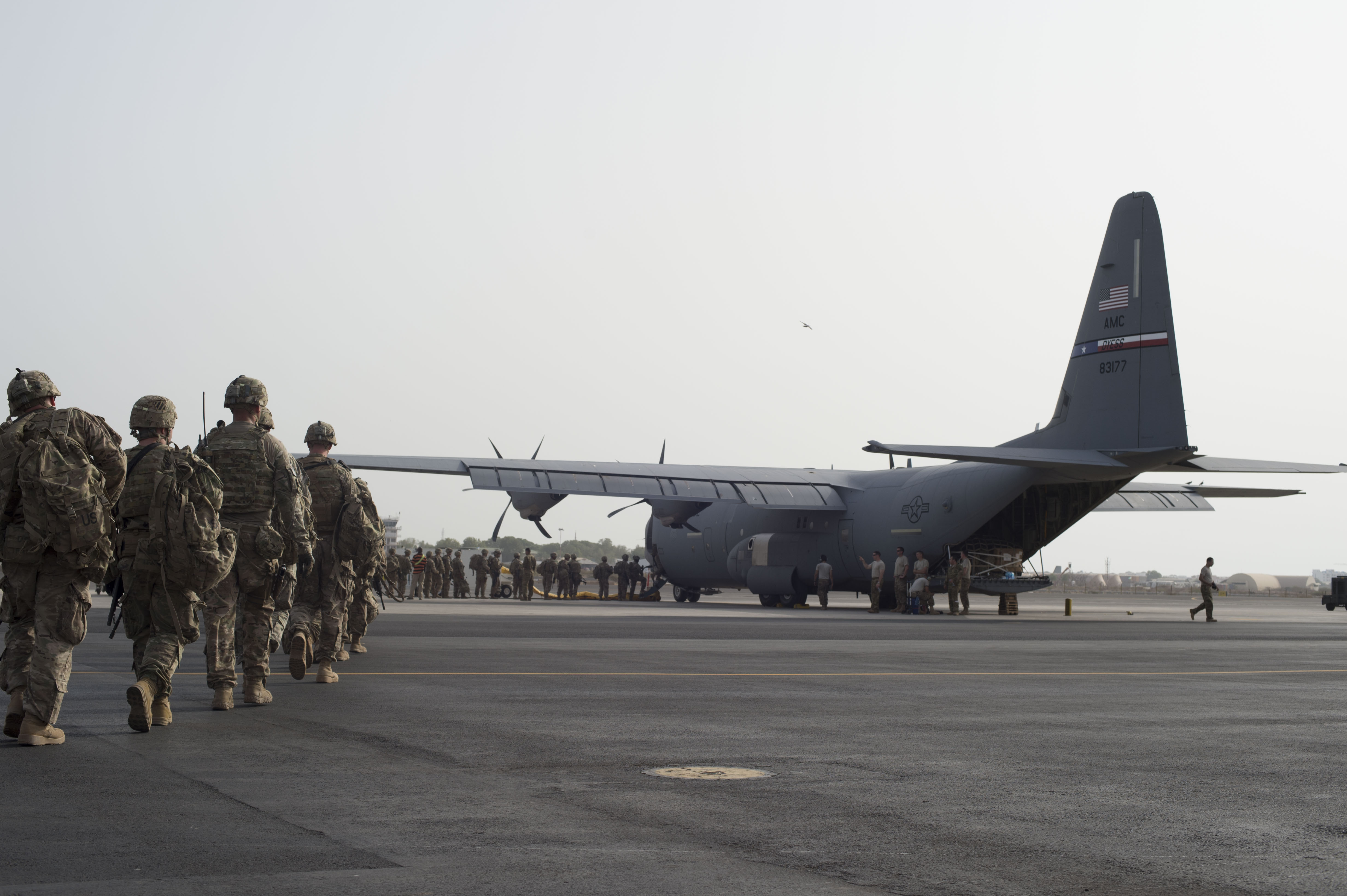 Tons of cargo and passengers are loaded on to a U.S. Air Force C-130J Hercules during an East African Response Force validation exercise May 27, 2016, at Camp Lemonnier, Djibouti. The mission of the EARF is to provide rapidly deployable assets at a moment's notice to reinforce embassies within the Combined Joint Task Force-Horn of Africa area of responsibility. (U.S. Air Force photo by Staff Sgt. Eric Summers, Jr./Released)