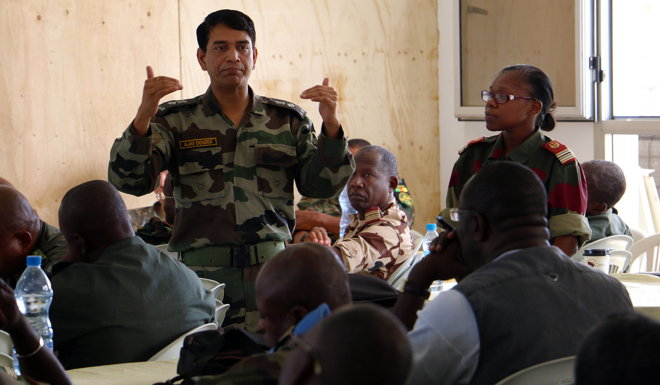 Indian Army Lt. Col. Ajay Dogra, military training officer with the United Nations Department of Peacekeeping Operations, teaches Central Accord 2016 participants about U.N. functions and procedures June 14, at the Cooperative Security Location in Libreville, Gabon. U.S. Army Africa's exercise Central Accord 2016 is an annual, combined, joint military exercise that brings together partner nations to practice and demonstrate proficiency in conducting peacekeeping operations. (U.S. Army Africa photo by Staff Sgt. Candace Mundt/Released)