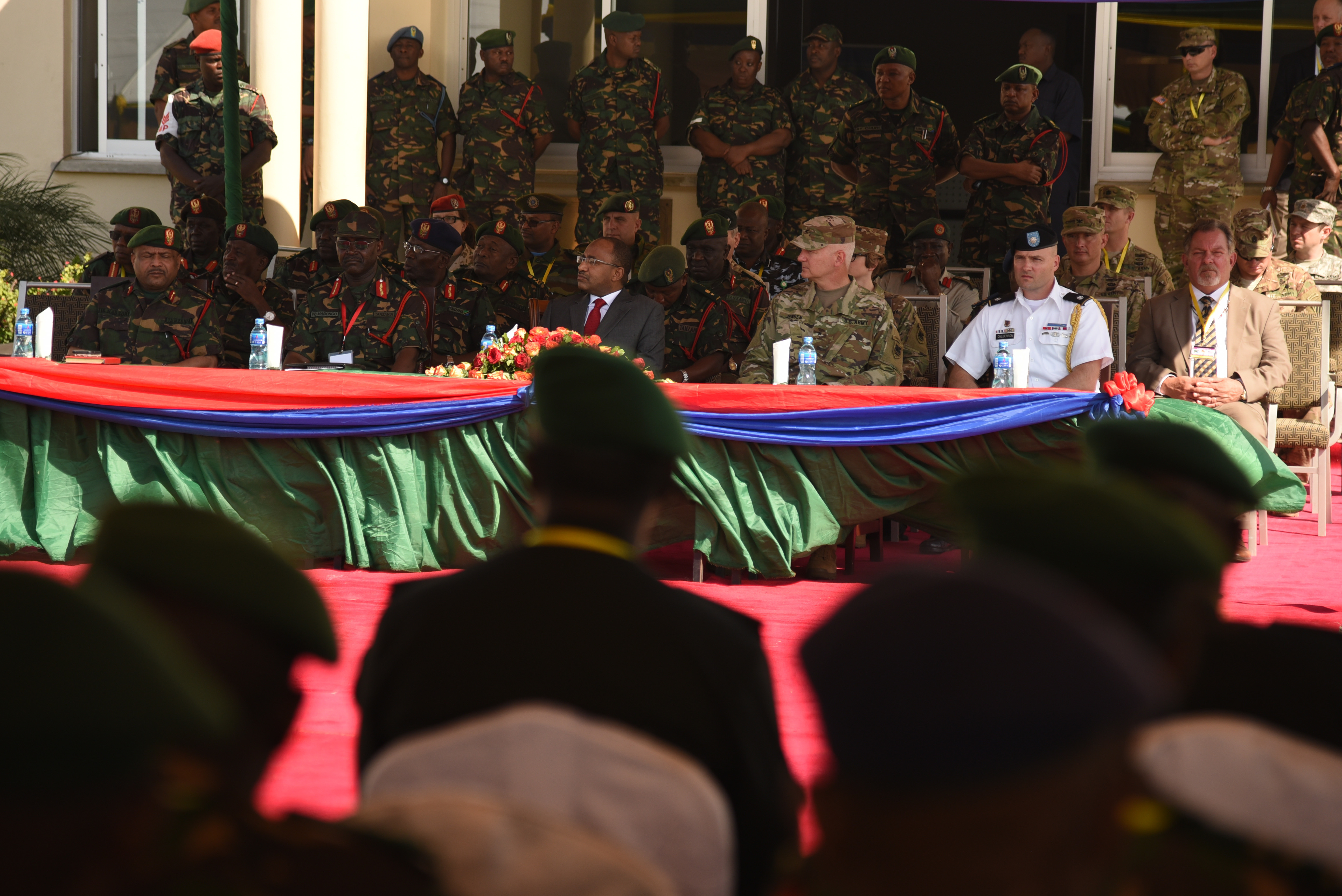 DAR ES SALAAM, Tanzania – Senior military leaders from the Tanzanian and U.S. militaries, alongside Hussein Ali Mwinyi, Tanzanian Minister of Defense and National Service, preside over the opening ceremony for exercise Eastern Accord 2016 at the Tanzanian Peacekeeping Training Centre, July 11, 2016, Dar es Salaam, Tanzania. EA16 is an annual, combined, joint military exercise that brings together partner nations to practice and demonstrate proficiency in conducting peacekeeping operations. (U.S. Air Force photo by Staff Sgt. Tiffany DeNault/Released)