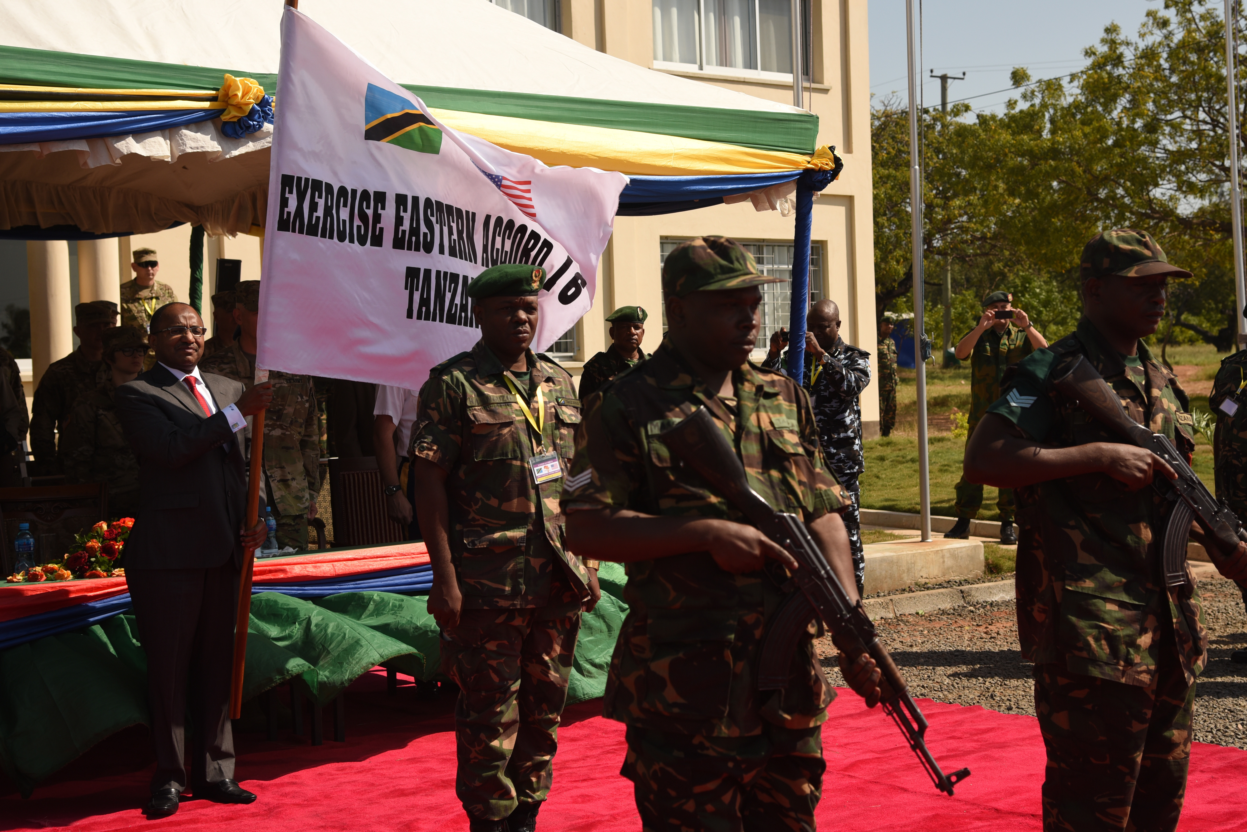 DAR ES SALAAM, Tanzania – Hussein Ali Mwyini, Minister of Defense and National Service, presents the Eastern Accord 2016 flag representing the commencement of the command post exercise the Tanzanian Peacekeeping Training Centre on July 11, 2016, in Dar es Salaam, Tanzania. EA16 is an annual, combined, joint military exercise that brings together partner nations to practice and demonstrate proficiency in conducting peacekeeping operations. (U.S. Air Force photo by Staff Sgt. Tiffany DeNault/Released)
