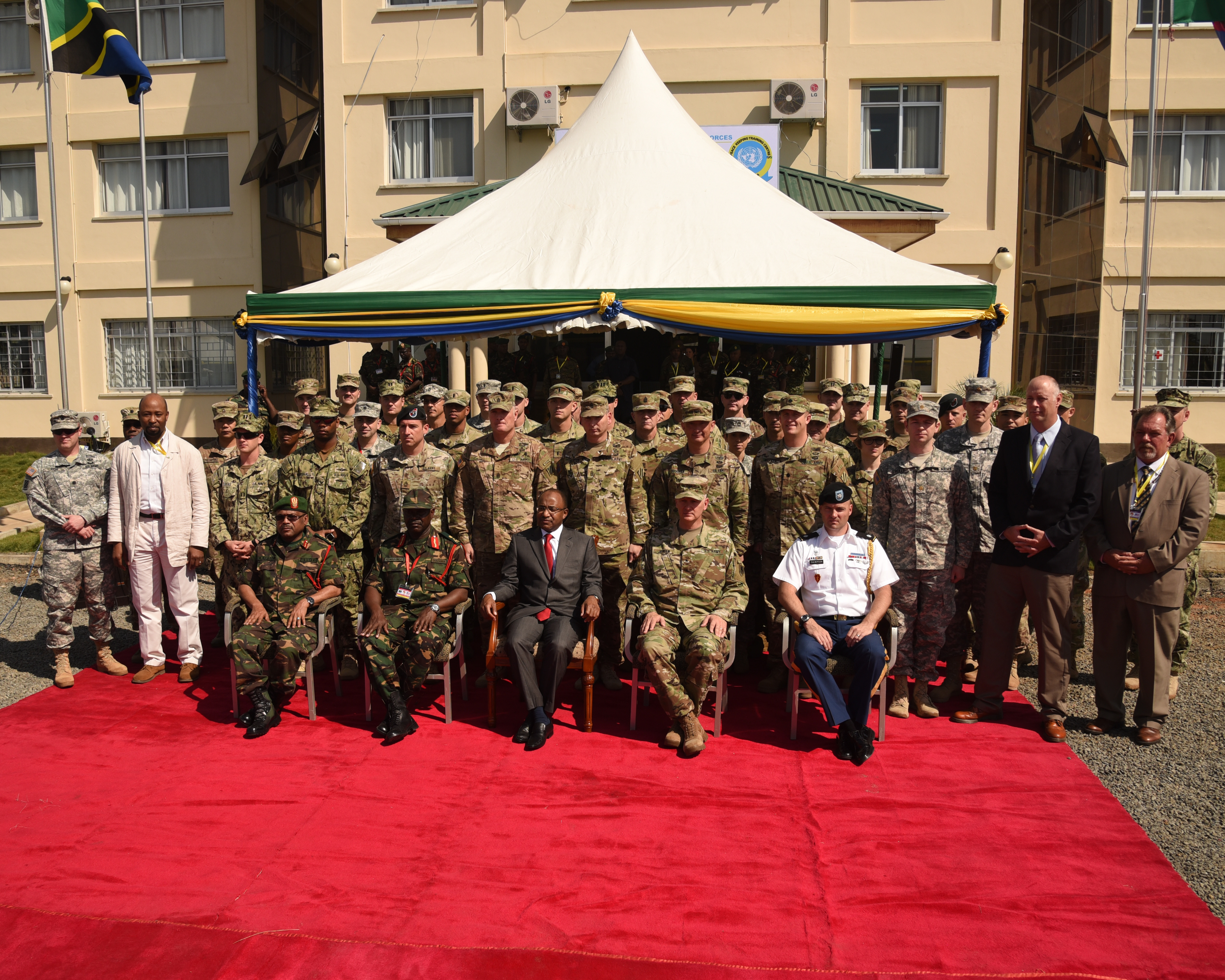 DAR ES SALAAM, Tanzania – Senior military leaders and Hussein Ali Mwyini, Minister of Defense and National Service, take a group photograph with the U.S. Eastern Accord 2016 participants at the Opening Ceremony at the Tanzanian Peacekeeping Training Centre on July 11, 2016, in Dar es Salaam, Tanzania. EA16 is an annual, combined, joint military exercise that brings together partner nations to practice and demonstrate proficiency in conducting peacekeeping operations. (U.S. Air Force photo by Staff Sgt. Tiffany DeNault/Released)