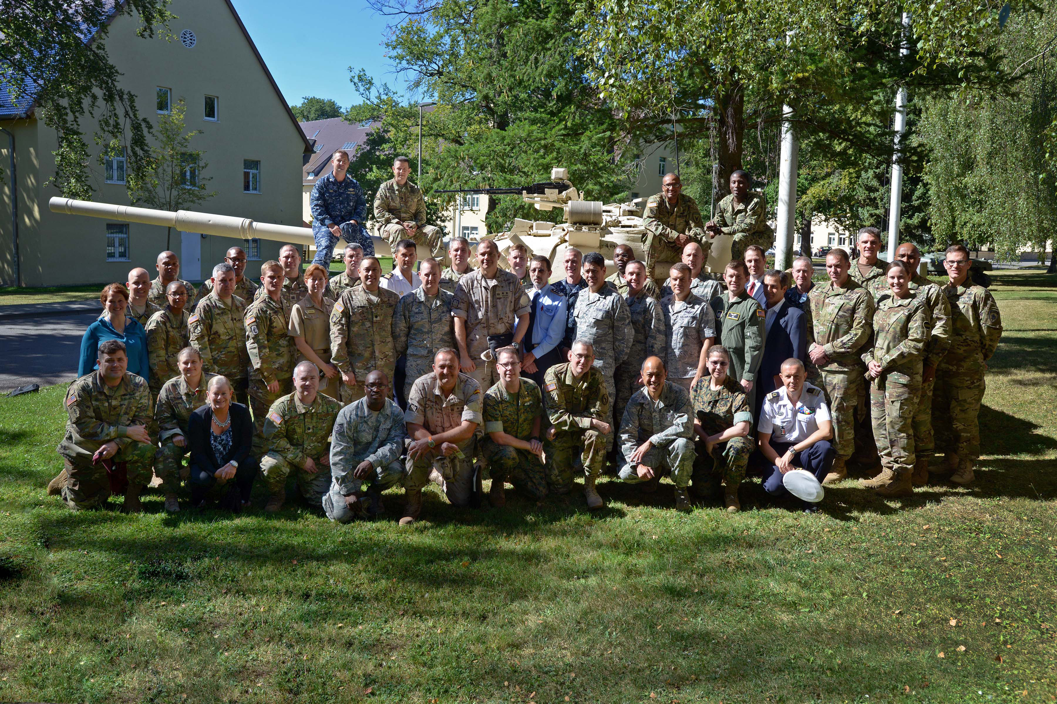 "STUTTGART, Germany (Aug. 24, 2016) -- Participants of the U.S. Africa Command's Surgeon's conference held 24-26 Aug. pose for a photo on Kelley Barracks. Entitled ""Strength Through Health,"" the conference allowed participants to discuss ways to leverage capabilities of all partners, including international and interagency, on the African continent to deliver health services to U.S. and combined forces. (Official Dept. of Defense photo by Jason D. Johnston/RELEASED)"