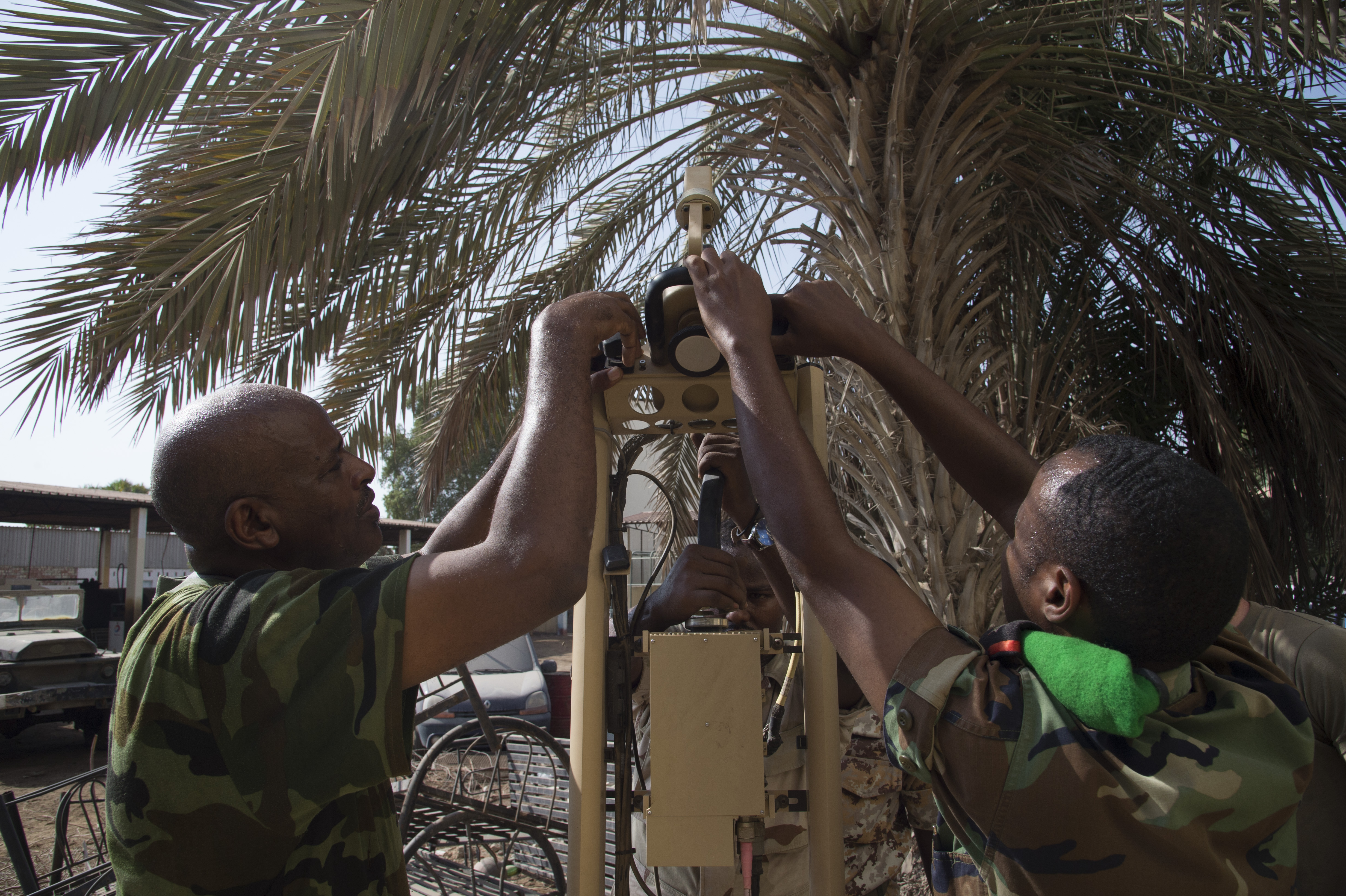 Djibouti Armed Forces (FAD) service members set up an Africa Data Sharing Network (ADSN) satellite during training validation Sept. 28, 2016, at FAD Headquarters in Djibouti. While conducting the best practices training, the U.S. Army, assigned to Combined Joint Task-Horn of Africa, also held an ADSN validation with the FAD soldiers to prepare them to deploy to Somalia.  The ADSN provides network and Voice over Internet Protocol capabilities between the several African countries participating in the Africa Union Mission in Somalia. (U.S. Air Force photo by Staff Sgt. Eric Summers Jr.)