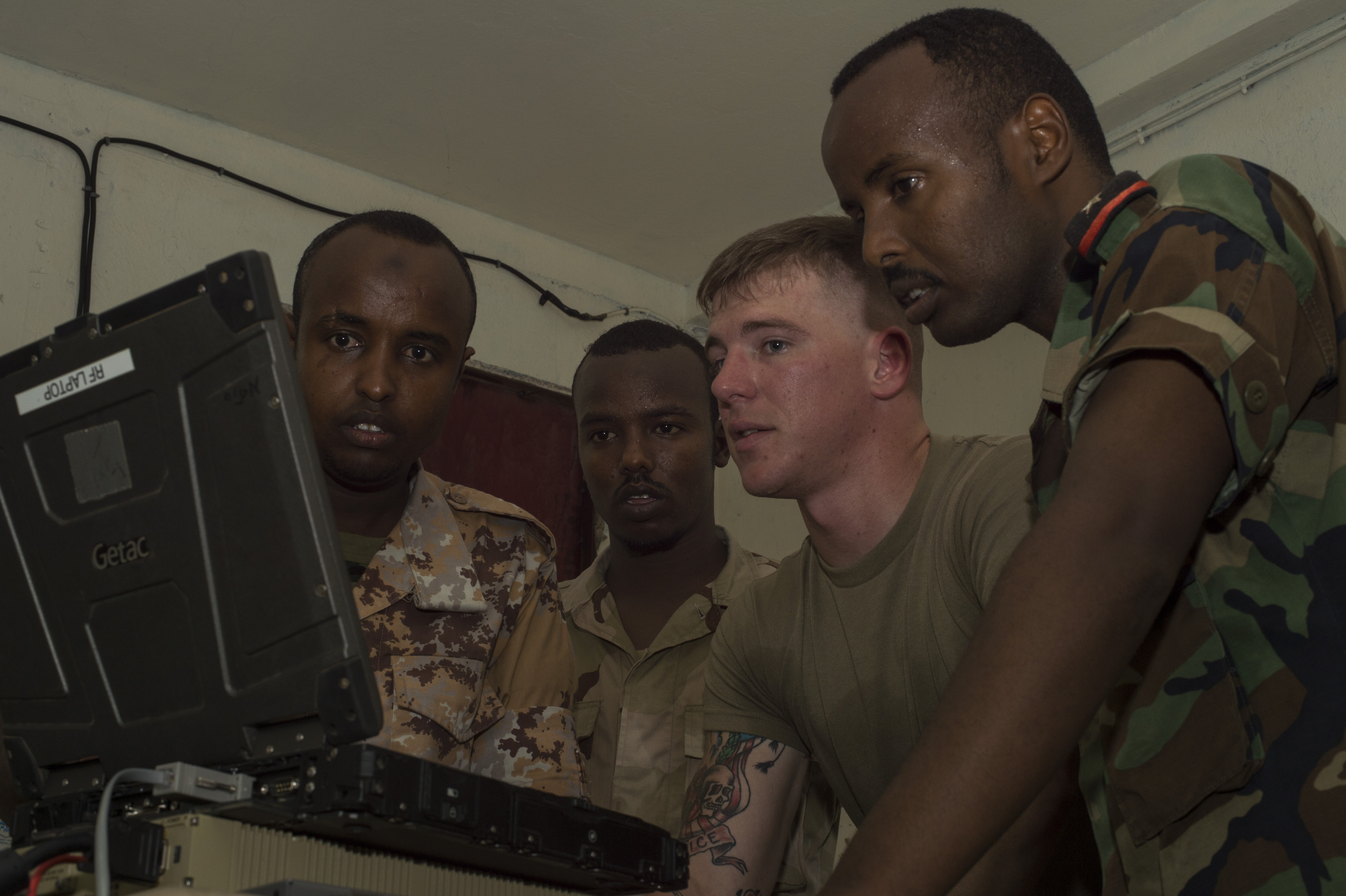 U.S. Army Spc. Dillin Hart, a Combined Joint Task Force-Horn of Africa technician on the Africa Data Sharing Network (ADSN) system, reviews network configurations with members of the Djibouti Armed Forces (FAD) during training validation Sept. 28, 2016, at FAD Headquarters in Djibouti.  While conducting the best practices training, the U.S. Army technicians assigned to Combined Joint Task-Horn of Africa, also held an ADSN validation with the FAD soldiers to prepare them to deploy to Somalia.  The ADSN provides network and Voice over Internet Protocol capabilities between the several African countries participating in the Africa Union Mission in Somalia. (U.S. Air Force photo by Staff Sgt. Eric Summers Jr./Released)