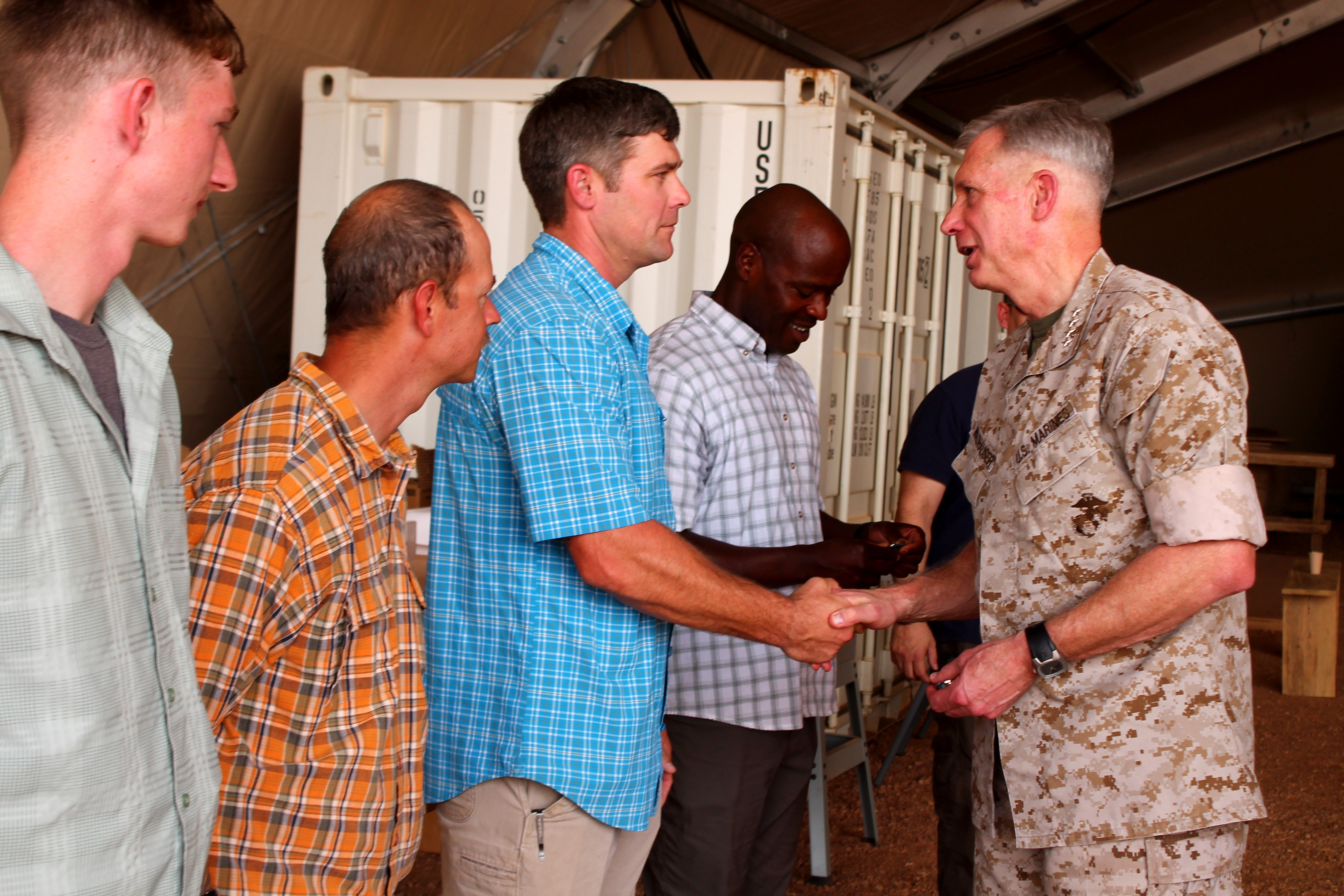 Gen. Thomas Waldhauser, Commander, U.S. Africa Command, presented official command coins to several U.S. civil affairs troops currently deployed to Niger's Air Base 201 on Nov. 1, 2016. (Photo by Samantha Reho, U.S. Africa Command Public Affairs/Released)
