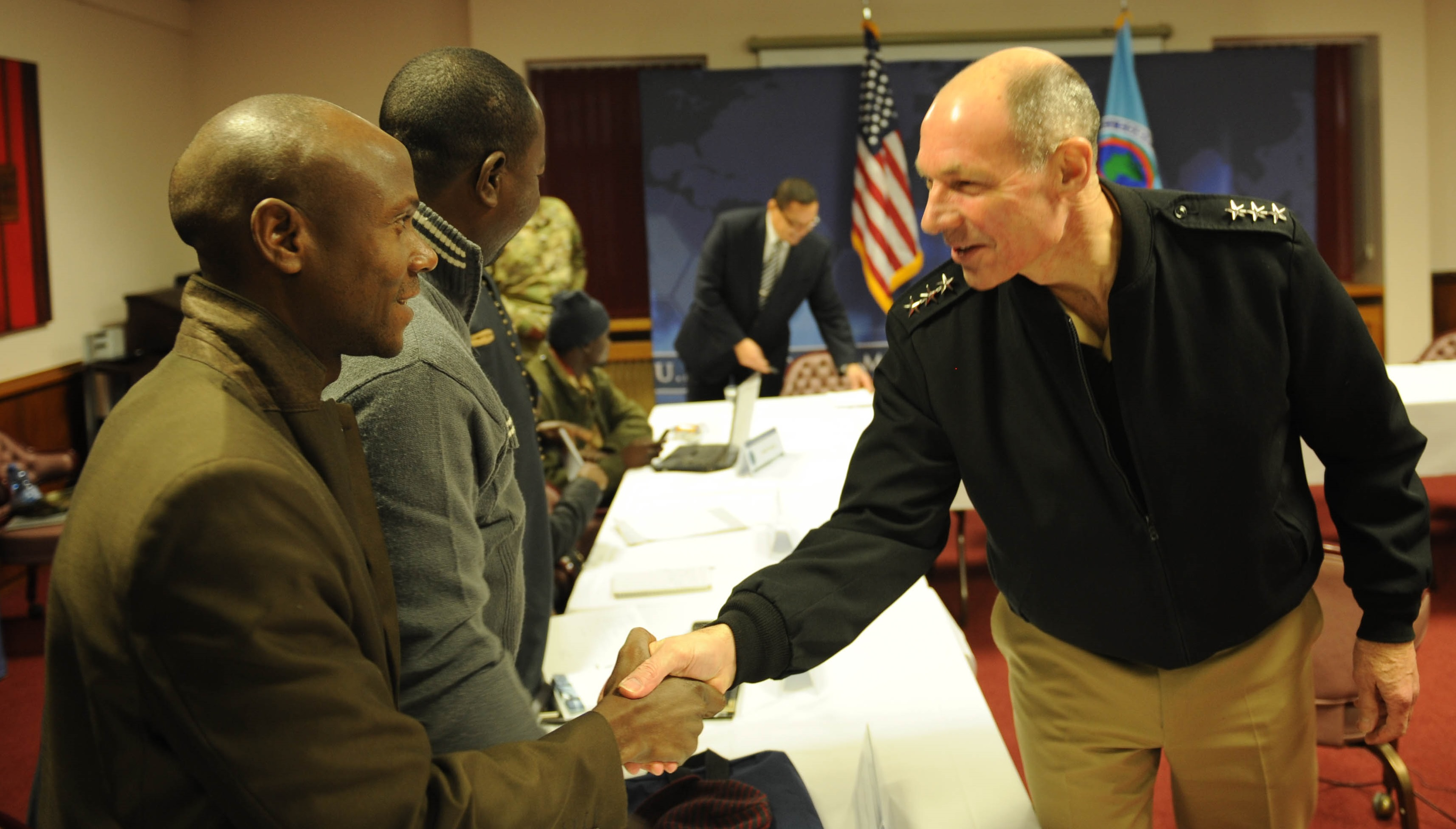 Saley Moustapha Hassane, director of Labari TV & Radio News (left) shakes hands with U.S. Navy Vice Adm. Michael Franken, deputy to the commander for military operations at U.S. Africa Command.  A media delegation of journalists from Cameroon and Niger were hosted by AFRICOM Nov. 28 – Dec. 1, 2016, at the U.S. Army Garrison Stuttgart.  The event provided an opportunity for journalists and reporters from the continent to learn about the command's mission, role and programs.  The week concluded with the journalists having the opportunity to interview both Franken, and U.S. Amb. Alexander Laskaris, AFRICOM's deputy for civil-military engagement. (U.S. Africa Command photo by U.S. Army Staff Sgt. Grady Jones/Released)