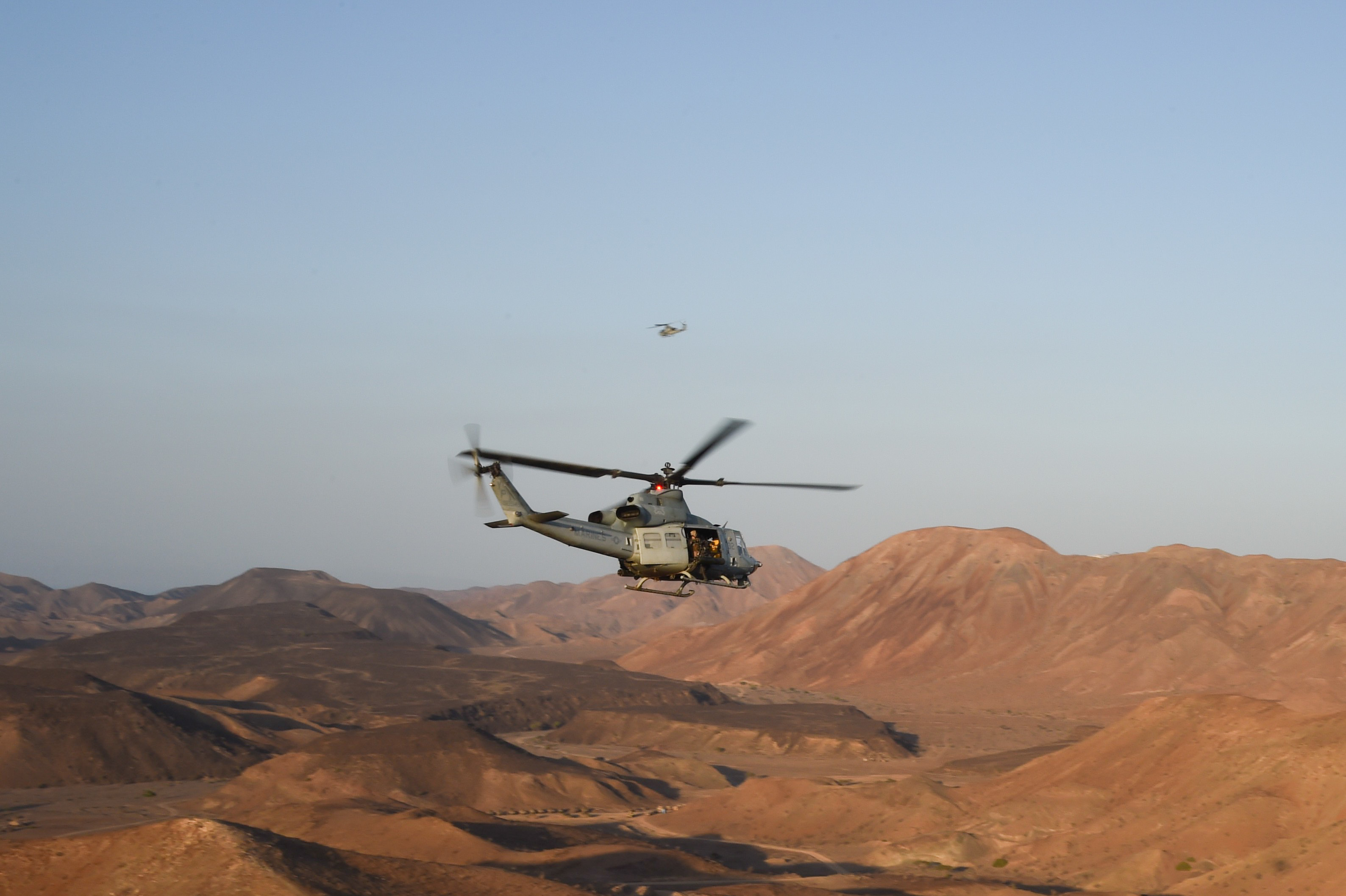 A UH-1Y Huey helicopter flies over the range after a helo-borne raid during Exercise Alligator Dagger, Dec. 18, 2016, at Arta Plage, Djibouti. The exercise allows opportunities for the 11th MEU to maintain their respective skills and proficiencies while intermittently participating in bilateral training with the French. (U.S. Air National Guard photo by Staff Sgt. Penny Snoozy)