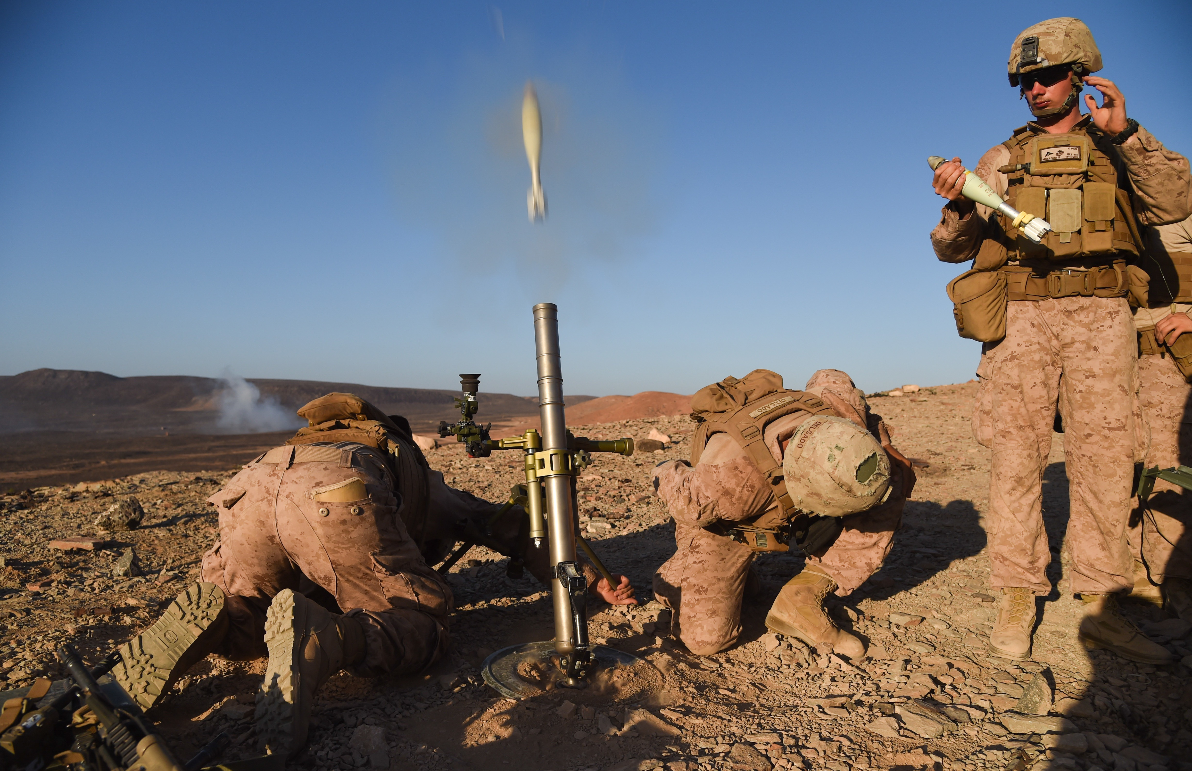 U.S. Marine Corps mortarmen, Weapons Platoon, Battalion Landing Team 1st Battalion, 4th Marines, 11th Marine Expeditionary Unit (MEU), fire a white phosphorous M722A1 round from a M224 60mm Lightweight Company Mortar System during exercise Alligator Dagger, Dec. 13, 2016, at Arta Plage, Djibouti. The M722A1 rounds, weighing just under four pounds, can be used for spotting or marking a target area with a smoke cloud. The exercise allows opportunities for the 11th MEU to maintain their respective skills and proficiencies. (U.S. Air National Guard photo by Staff Sgt. Penny Snoozy)