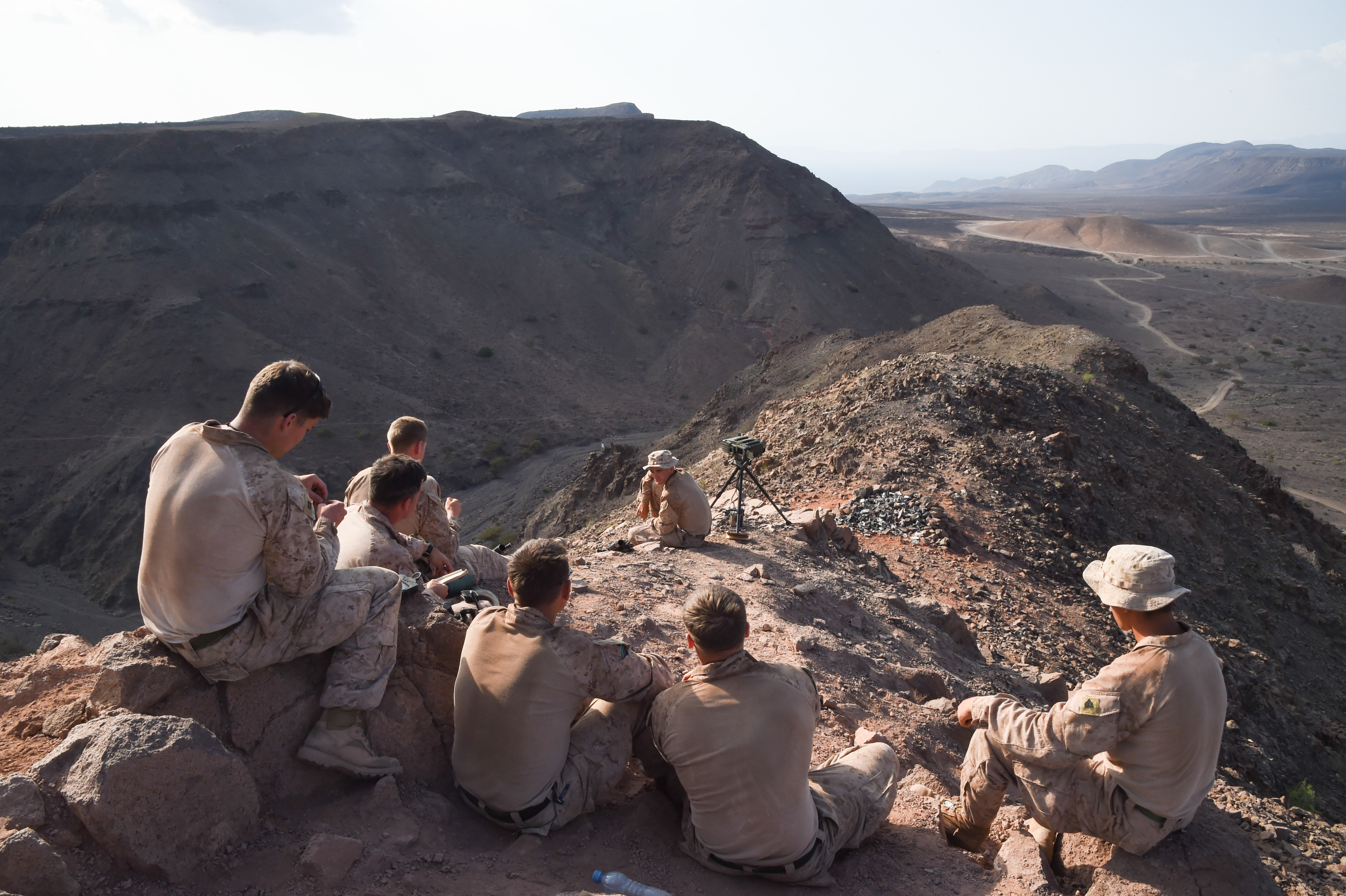 U.S. Marine Corps members with 1st Air Naval Gunfire Liaison Company (ANGLICO), 11th Marine Expeditionary Unit (MEU), wait to communicate with players during a helo-borne raid on the range during Exercise Alligator Dagger, Dec. 18, 2016, at Arta Plage, Djibouti. The exercise allows opportunities for the 11th MEU to maintain their respective skills and proficiencies while intermittently participating in bilateral training with the French. (U.S. Air National Guard photo by Staff Sgt. Penny Snoozy)