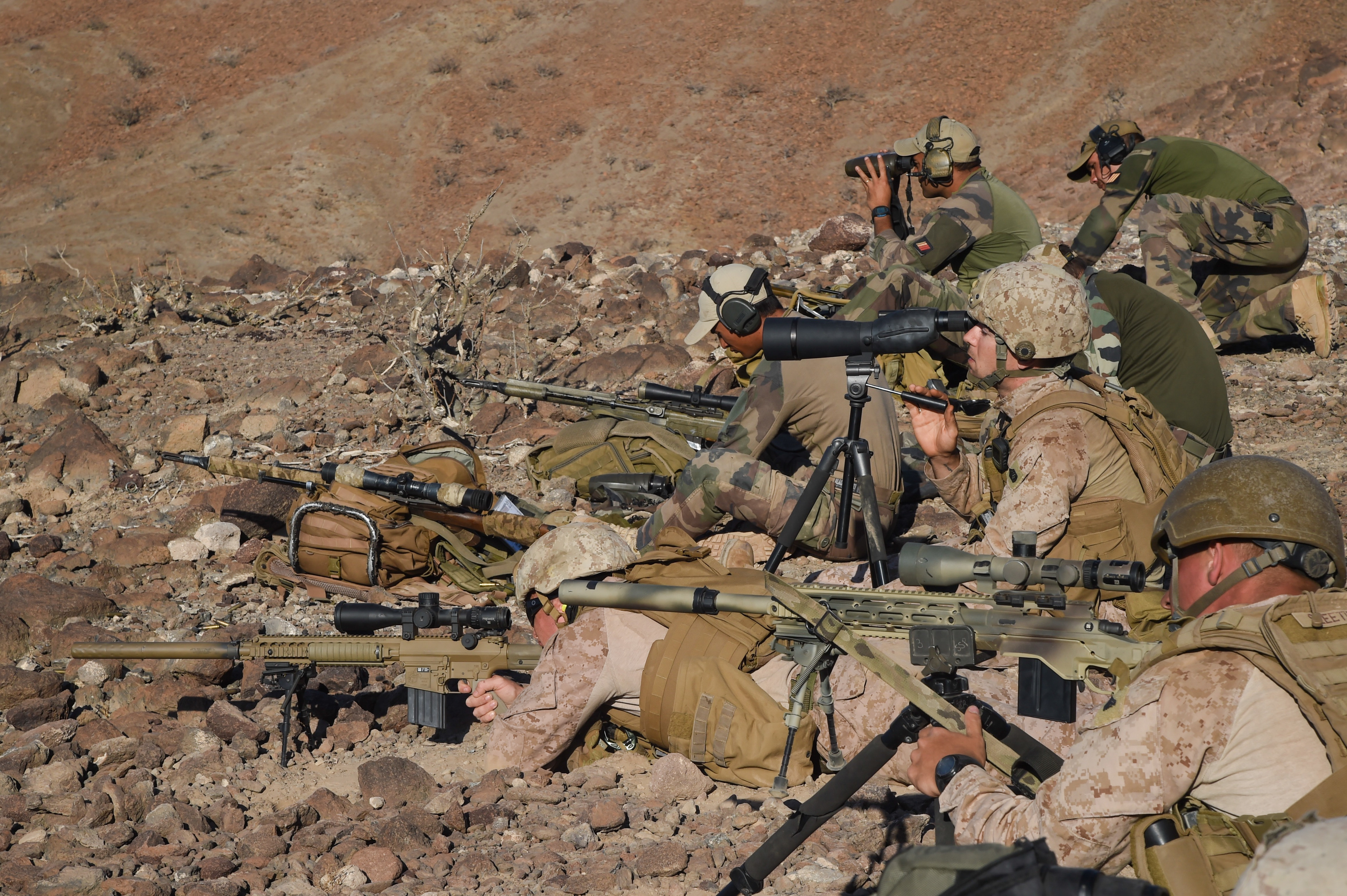 U.S. Marine Corps 2nd Lt. Joshua Gray, Scout Sniper Platoon, Battalion Landing Team 1st Battalion, 4th Marines, 11th Marine Expeditionary Unit (MEU), speaks with the 3rd Infantry French Marines' Sniper Platoon during exercise Alligator Dagger, Dec. 13, 2016, at Arta Plage, Djibouti. The Marines participated in an unknown distance course as a part of bilateral training with the French. The exercise allows opportunities for the 11th MEU to maintain their respective skills and proficiencies. (U.S. Air National Guard photo by Staff Sgt. Penny Snoozy)