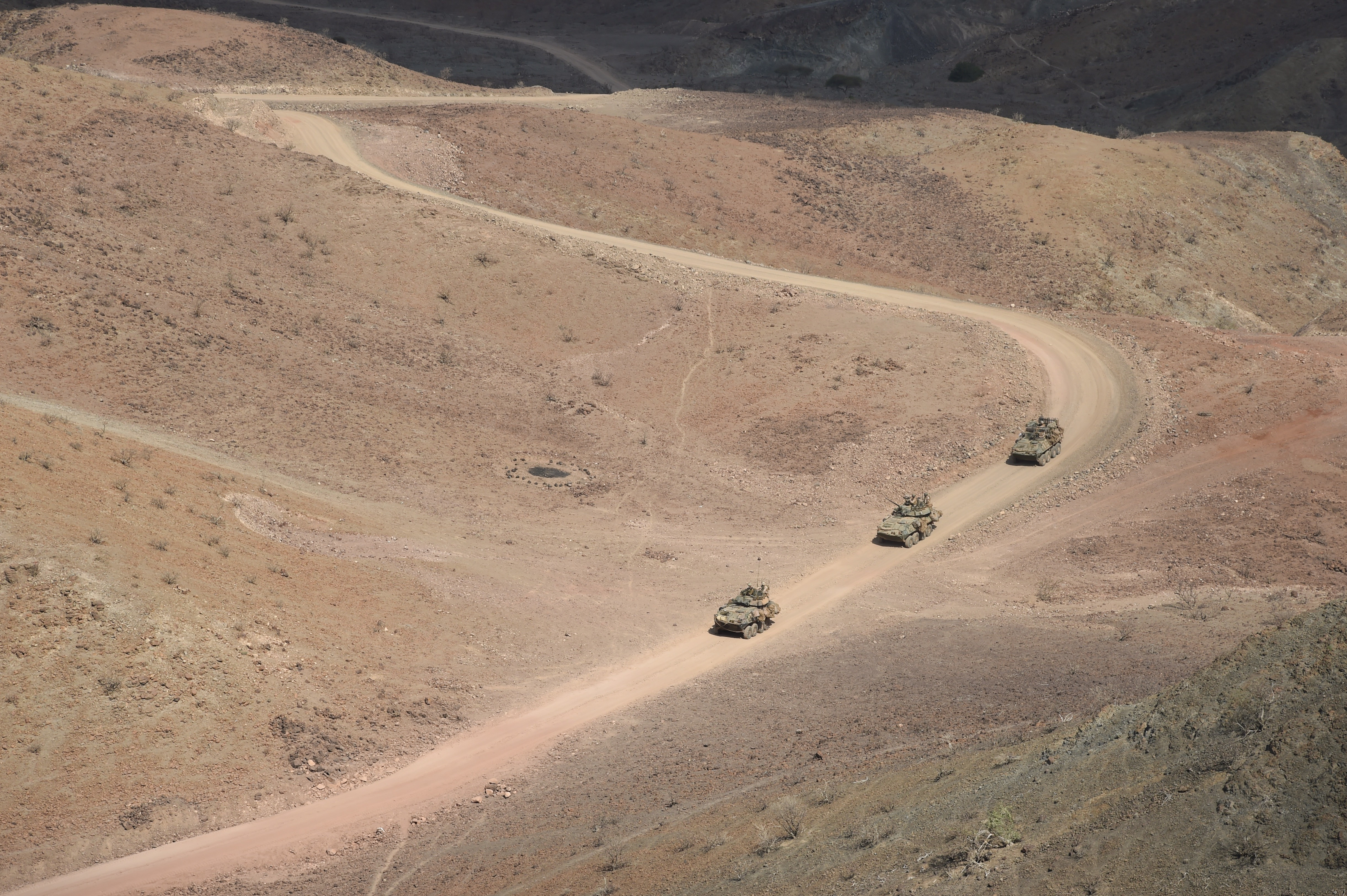 U.S. Marine Corps light armored vehicles, 11th Marine Expeditionary Unit (MEU), traverse the range during events of exercise Alligator Dagger, Dec. 18, 2016, at Arta Plage, Djibouti. The exercise allows the MEU to get off ship and conduct combat sustainment training to maintain their respective skills and proficiencies. (U.S. Air National Guard photo by Staff Sgt. Penny Snoozy)