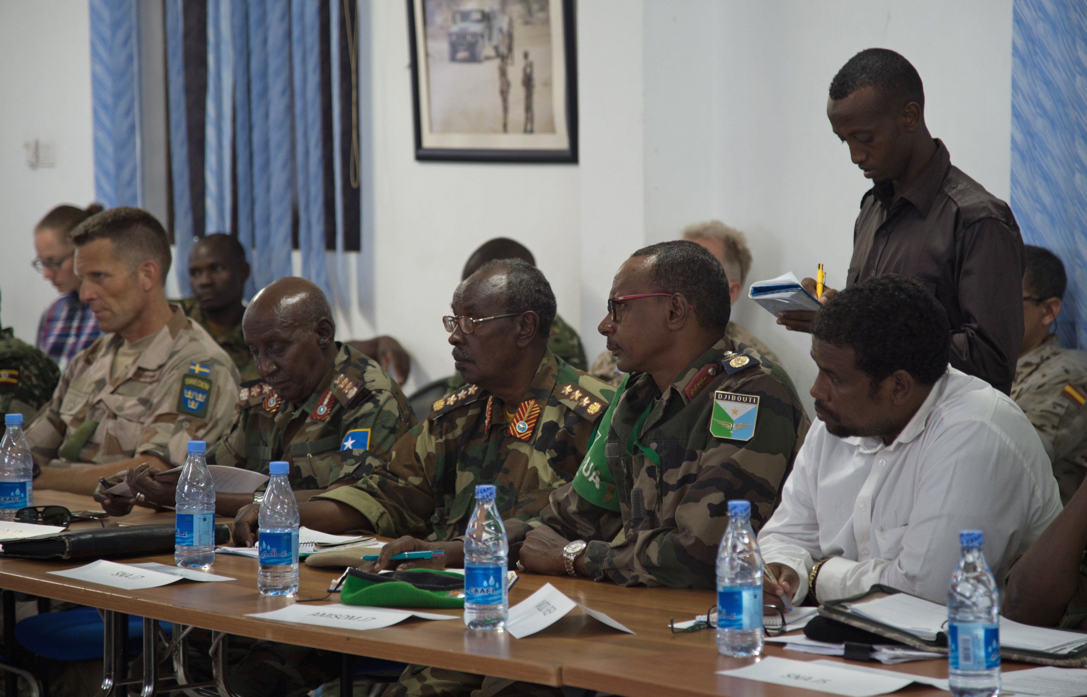 Leaders of the Somali National Army meet with international military and civilian officials to discuss the future of Somalia's security at the SNA Symposium in downtown Mogadishu, Jan. 11, 2017. More than 60 participants attended the two-day event, including representatives from Denmark, Germany, Italy, Somalia, Turkey, Uganda, the United Arab Emirates, United Kingdom and the United States of America. Also in attendance, were representatives from international organizations such as the United Nations, European Union Training Mission, and the African Union Mission in Somalia. (Photo by  Master Sgt. Paul Gorman/Released)
