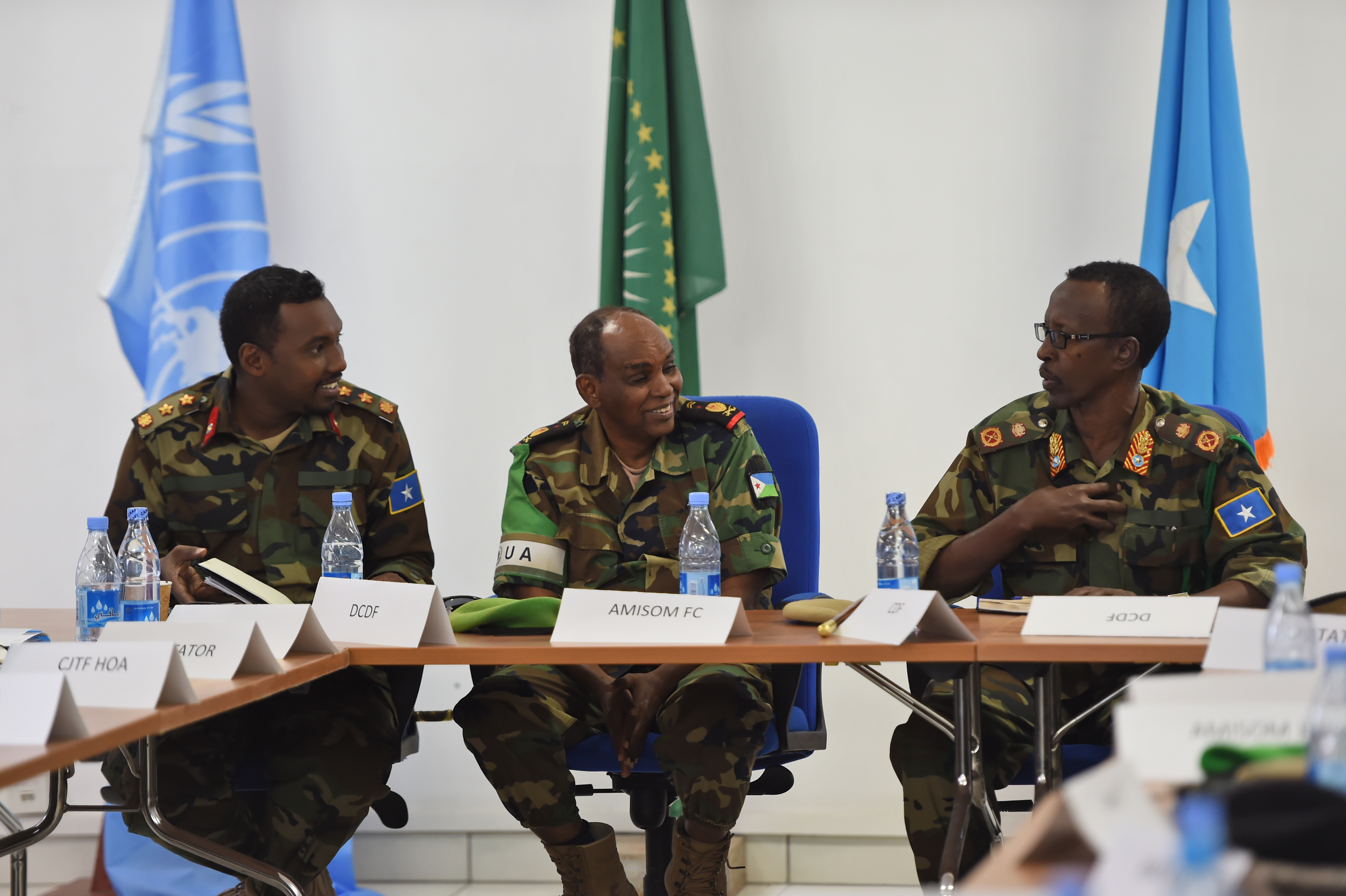 Somali National Army Chief of Defense Forces Maj. Gen. Mohammed Adan Ahmed, right, and Chief of Staff Col. Ahmed Mohammed, left, converse with African Union Mission in Somalia Col. Ali Noor during the SNA Symposium in downtown Mogadishu, Jan. 12, 2017. The symposium is part of an ongoing international effort to aid security conditions throughout Somalia by fostering the growth and revitalization of the national military defense force, which disbanded following the collapse of the country's central government in 1991. (Photo by Master Sgt. Paul Gorman/Released)