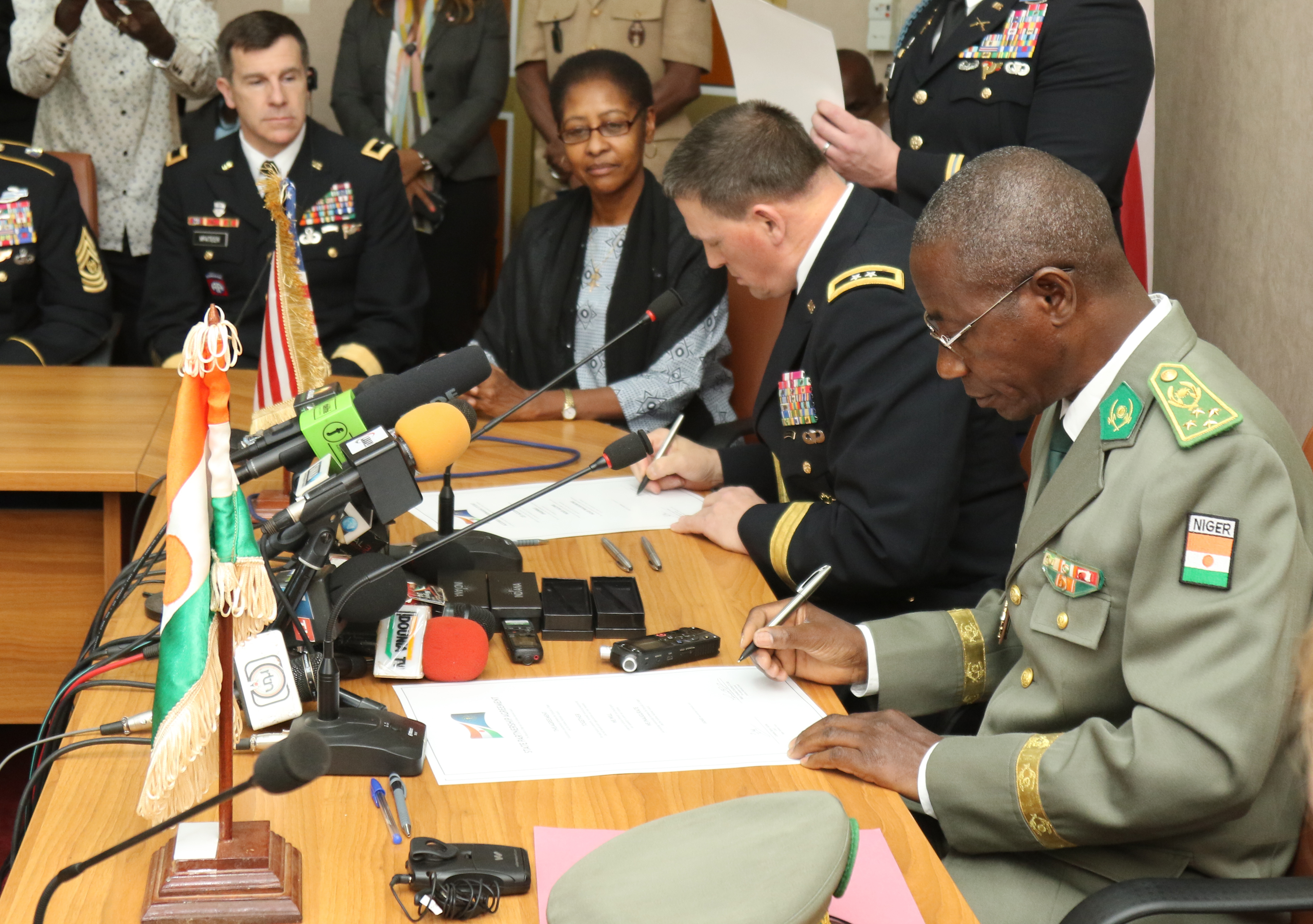 Niamey, Niger - Maj. Gen. Courtney P. Carr, the Adjutant General of Indiana, and Gen. Seyni Garba, Joint Chief of Staff of the Niger Armed Forces, sign a ceremonial partnership agreement during the State Partnership Program ceremony in Niamey, Niger. (Photo by Nate Herring, U.S. AFRICOM Public Affairs/Released)