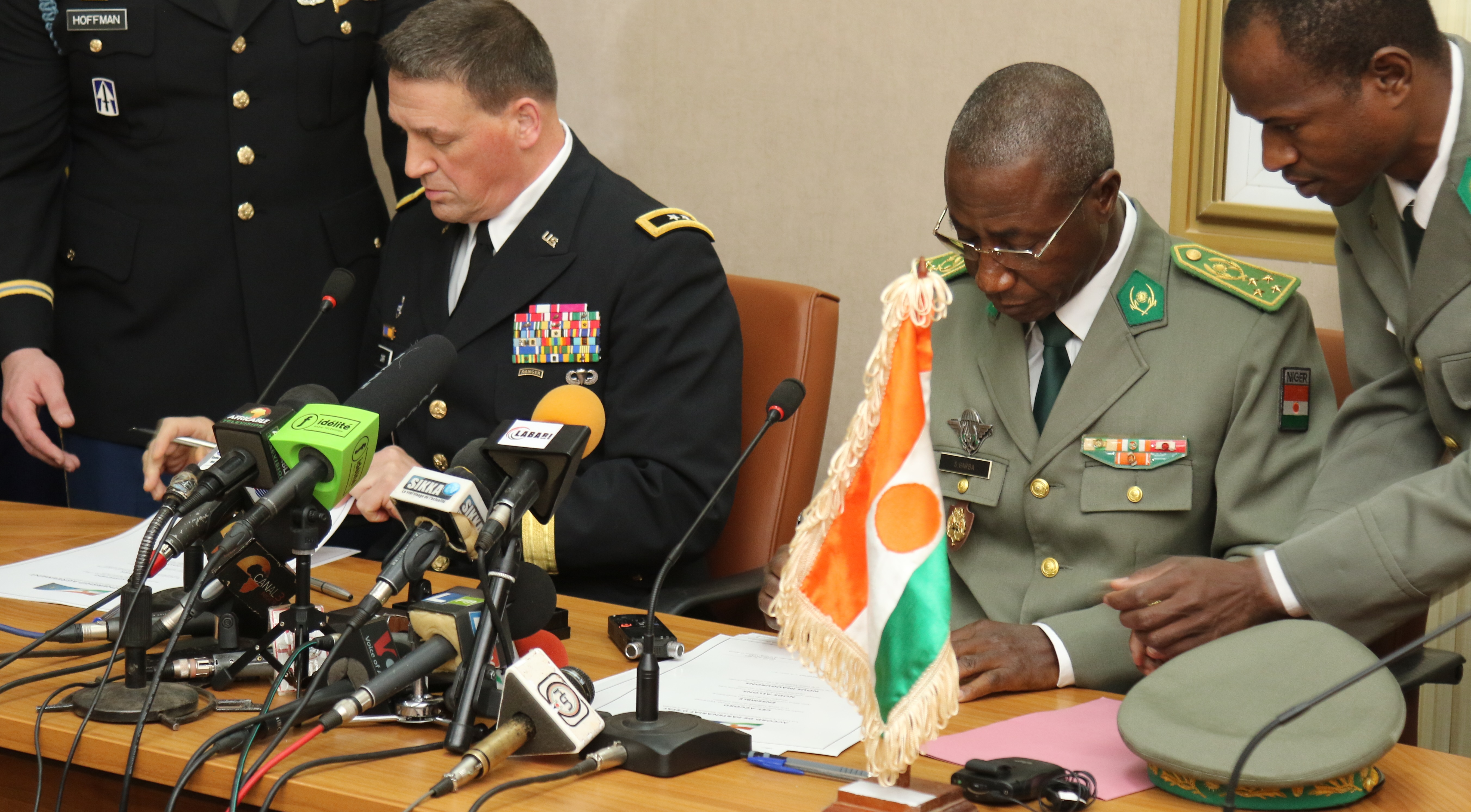 NIAMEY, Niger - Maj. Gen. Courtney P. Carr, the Adjutant General of Indiana, and Gen. Seyni Garba, Joint Chief of Staff of the Niger Armed Forces, sign a ceremonial partnership agreement during the State Partnership Program signing ceremony in Niamey, Niger. (Photo by Nate Herring, U.S. AFRICOM Public Affairs/Released)