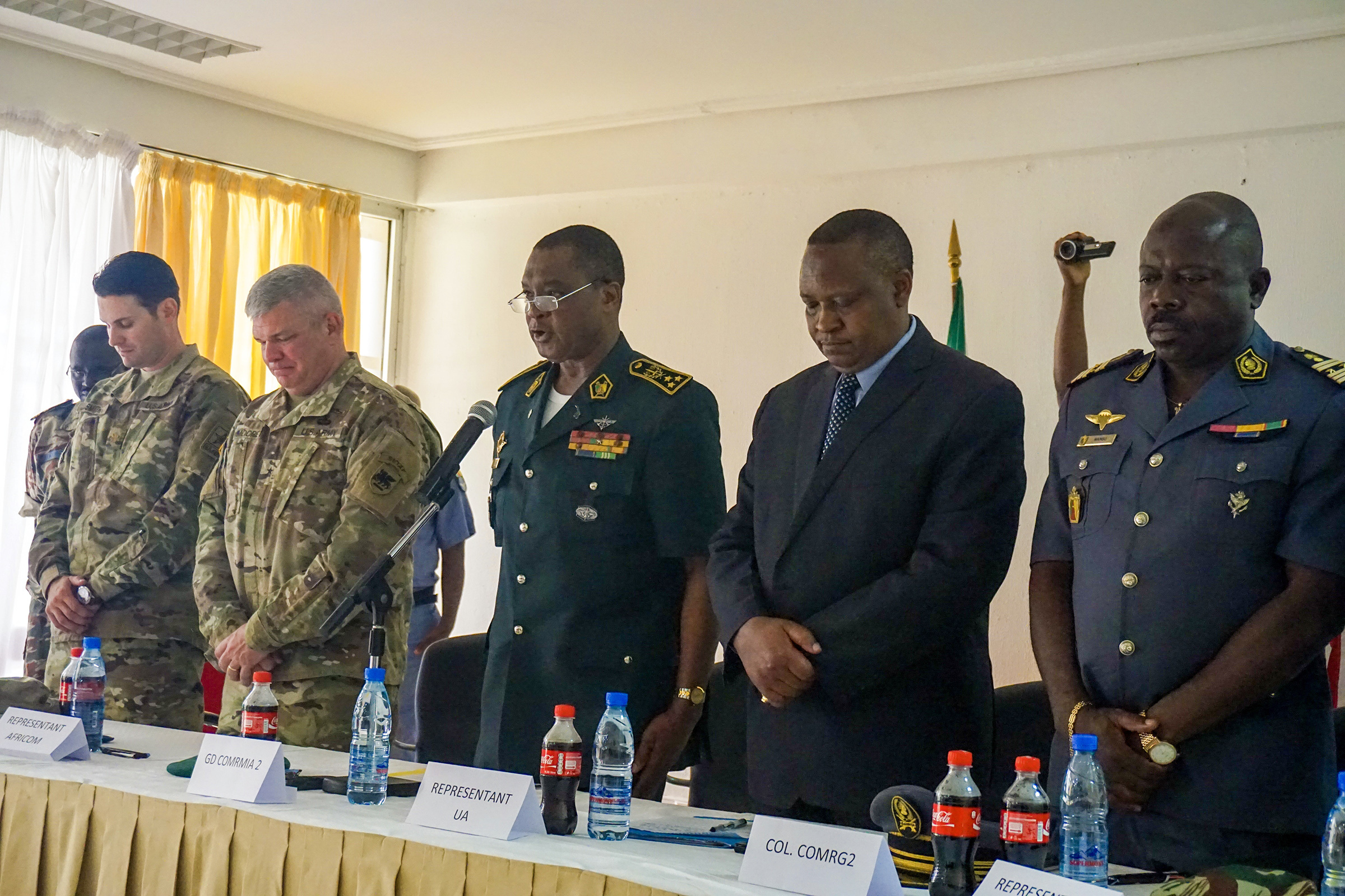Senior representatives from the U.S. and Cameroon share a moment of silence for the recent loss of Cameroonian Brig. Gen. Jacob Kodji and three officers in a helicopter crash during the opening ceremony for the Unified Focus 2017 final planning event (FPE), Douala, Cameroon, Feb. 6, 2017. The UF17 FPE brought partner nation planners together to discuss and shape the inaugural Unified Focus exercise designed to enhance and enable Lake Chad Basin Commission.  (U.S. Army Africa photo by Capt. Jason Welch/Released)