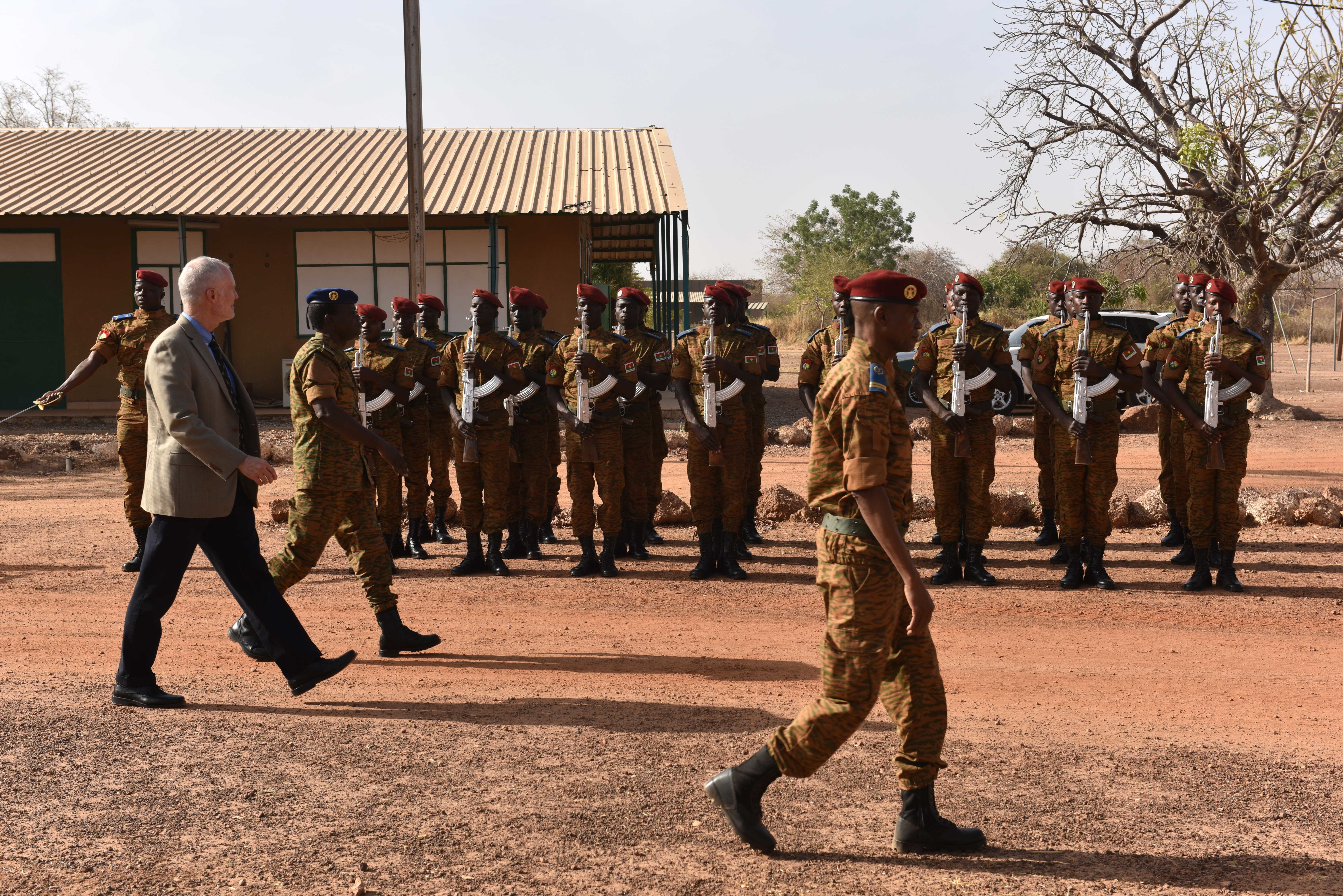 David Young, the Deputy Chief of Mission for the U.S. Embassy Burkina Faso, is greeted by soldiers of  the Burkina Faso Army during the opening ceremony for Flintlock 2017 on Feb. 27, at Camp Zagre, Burkina Faso. Seven African partner nations are participating in Flintlock 2017 to include Burkina Faso, Niger, Morocco, Tunisia, Chad, Cameroon, and Mauritania. (U.S. Army photo by Sgt Benjamin Northcutt 3rd Special Forces Group (Airborne) Public Affairs Sergeant/released)