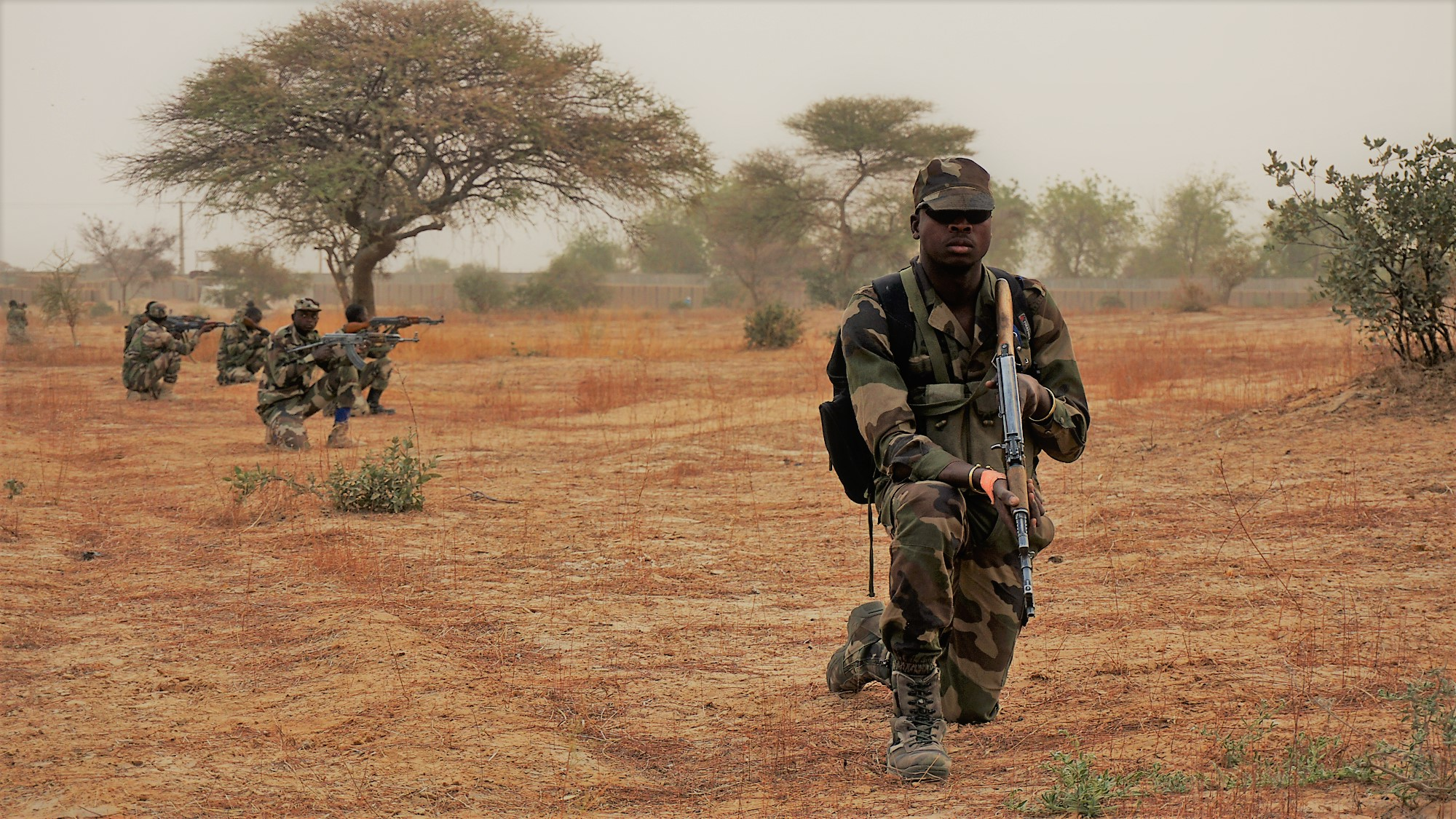 A Nigerien soldier provides rear security for his squad while they performed a dismounted patrol during Exercise Flintlock 2017 in Diffa, Niger, March 11, 2017. Flintlock exercises strengthen security institutions, promote multilateral sharing of information, and develop interoperability among partner nations in the Trans-Sahara. (U.S. Army photo by Spc. Zayid Ballesteros/Released)