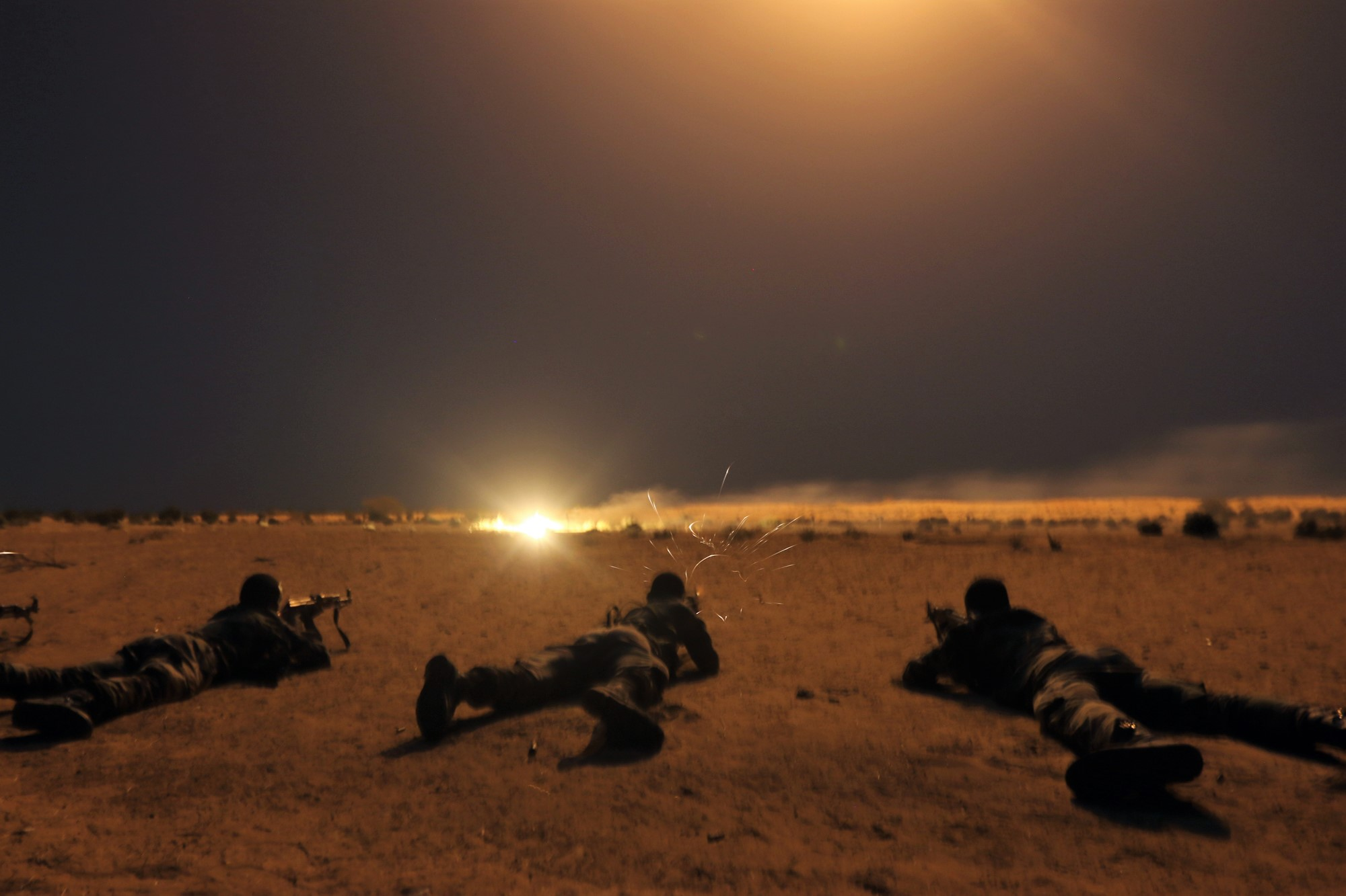 Nigerien army soldiers shoot targets under 60mm illumination mortar rounds as a part of Exercise Flintlock 2017 in Diffa, Niger, March 9, 2017. Skills learned at Flintlock enable warriors in the multinational fight against violent extremist organizations. (Photo by  Staff Sgt. Kulani Lakanaria/Released)
