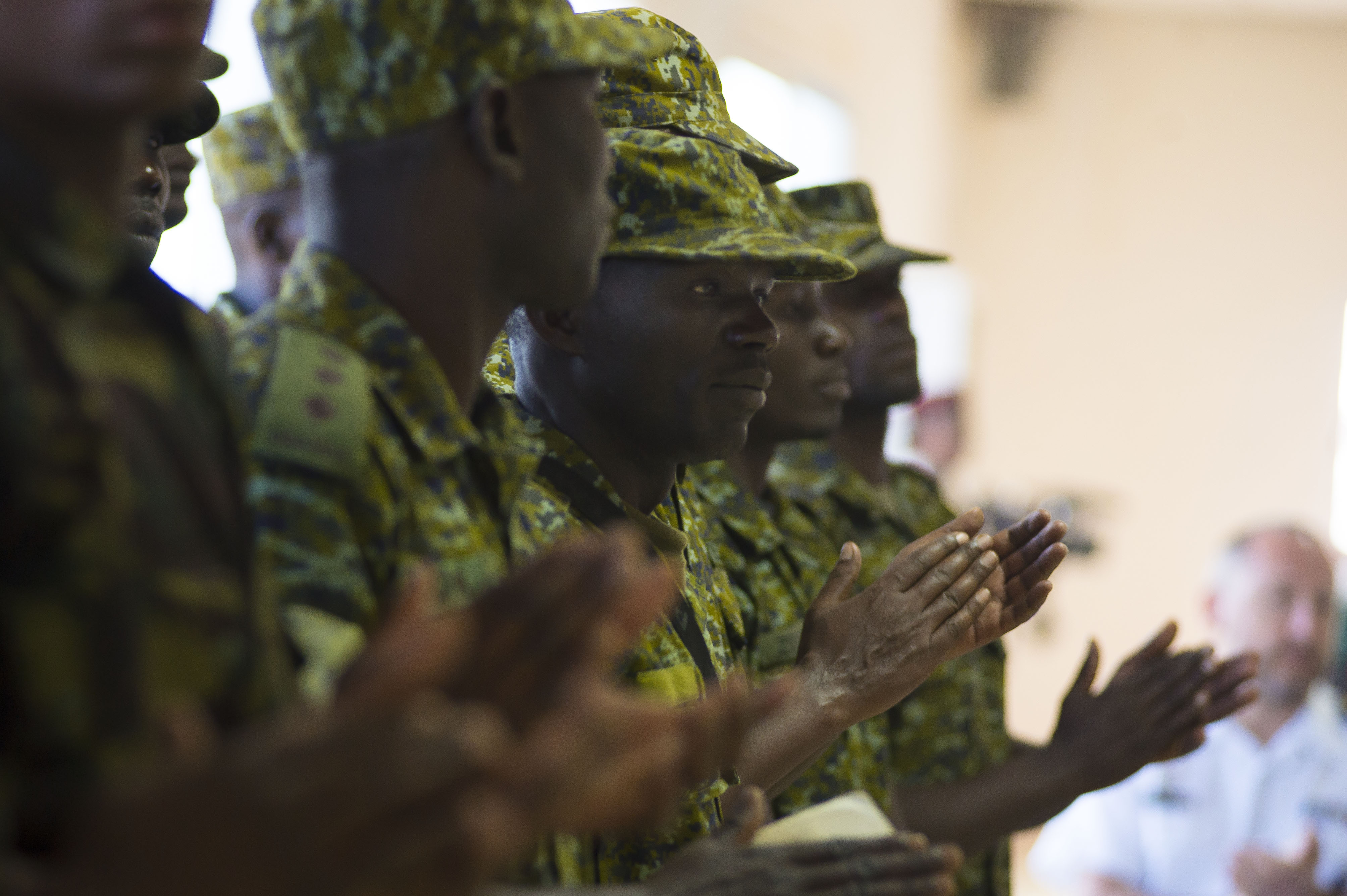 DJIBOUTI, Djibouti (Feb. 8, 2017) - Uganda Marines attend the exercise Cutlass Express 2017 closing ceremony at the Djibouti Coast Guard base Feb. 8, 2017. Exercise Cutlass Express 2017, sponsored by U.S. Africa Command and conducted by U.S. Naval Forces Africa, is designed to assess and improve combined maritime law enforcement capacity and promote national and regional security in East Africa. (U.S. Navy photo by Mass Communication Specialist 3rd Class Robert Price/Released)