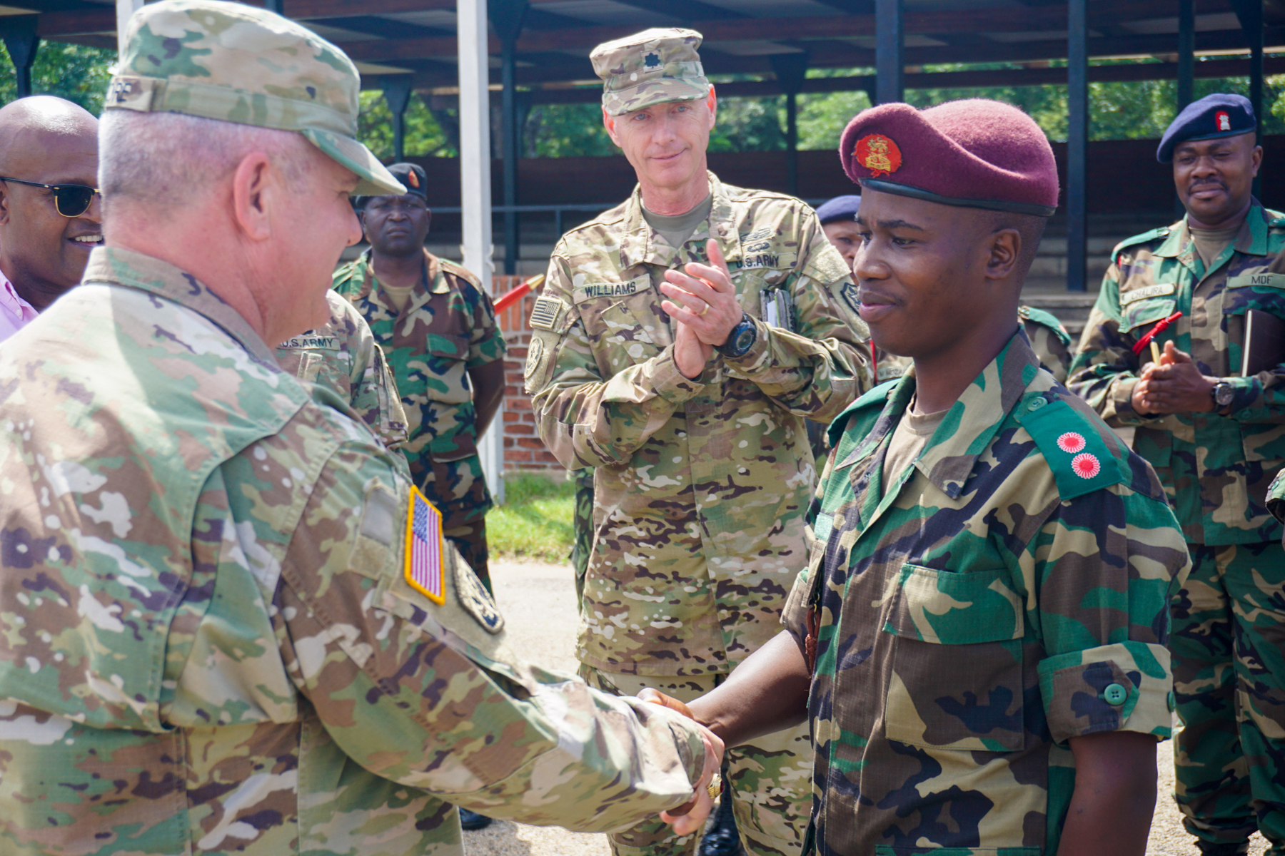 U.S. Army Brig. Gen. Kenneth Moore, U.S. Army Africa deputy commander, thanks a Malawi airborne lieutenant after he briefed the gathered Malawi and U.S. military planners near the Malawi Armed Forces College, Salima, Malawi, during the final planning event for the Africa Land Forces Summit 2017, March 28, 2017. ALFS is an annual, weeklong seminar bringing together land force chiefs from across Africa for candid dialog to discuss and develop cooperative solutions to regional and trans-regional challenges and threats.