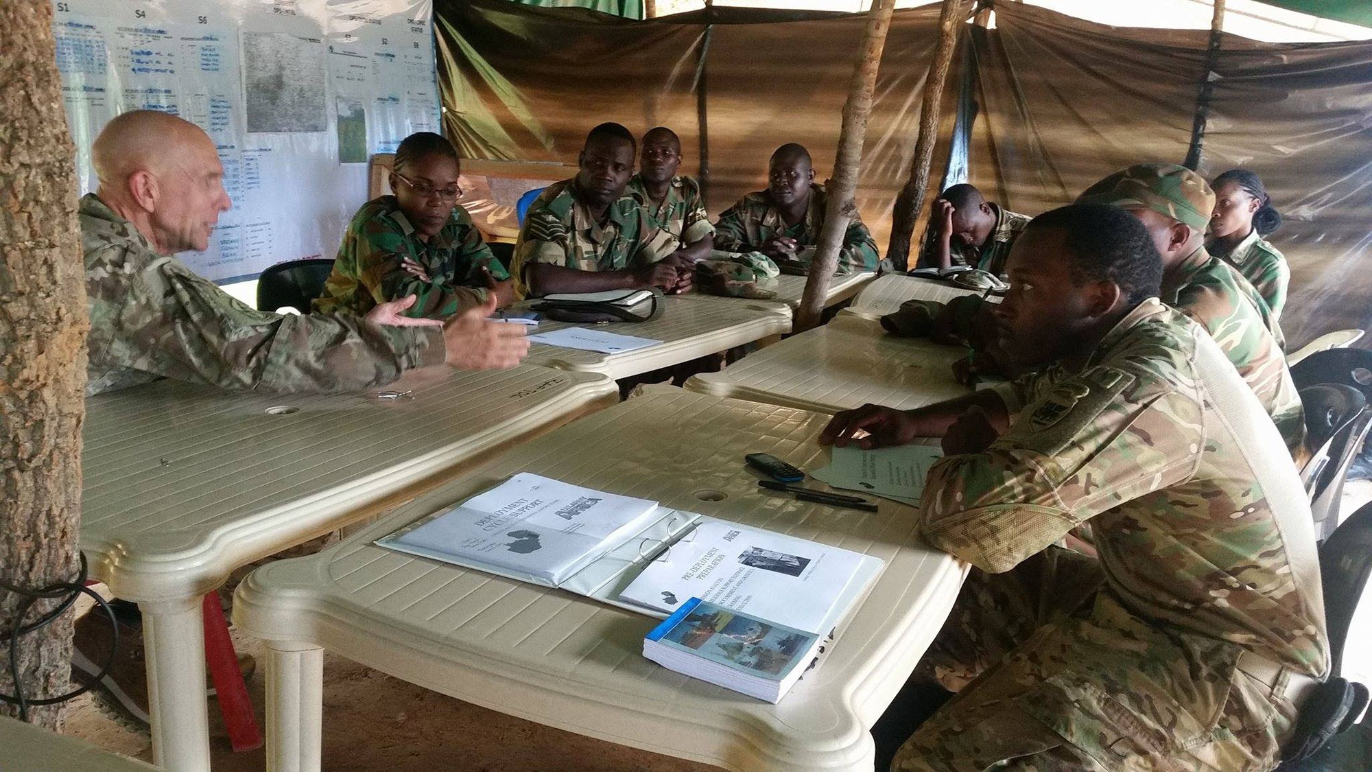 Chaplain (Col.) David Lile (left), the U.S. Army Africa command chaplain, conducts a training for Zambian army and air force chaplain teams at the Nanking army battle training center near Lusaka, Zambia, March 13, 2017. Lile and Sgt. 1st Class George Butler, also assigned the USARAF chaplain section based in Vicenza, Italy, discussed deployment cycle support and spiritual leadership and development components with the Zambian chaplains, who were preparing to support service members scheduled to deploy to Central African Republic and South Sudan on extended peacekeeping missions. (Courtesy photo)