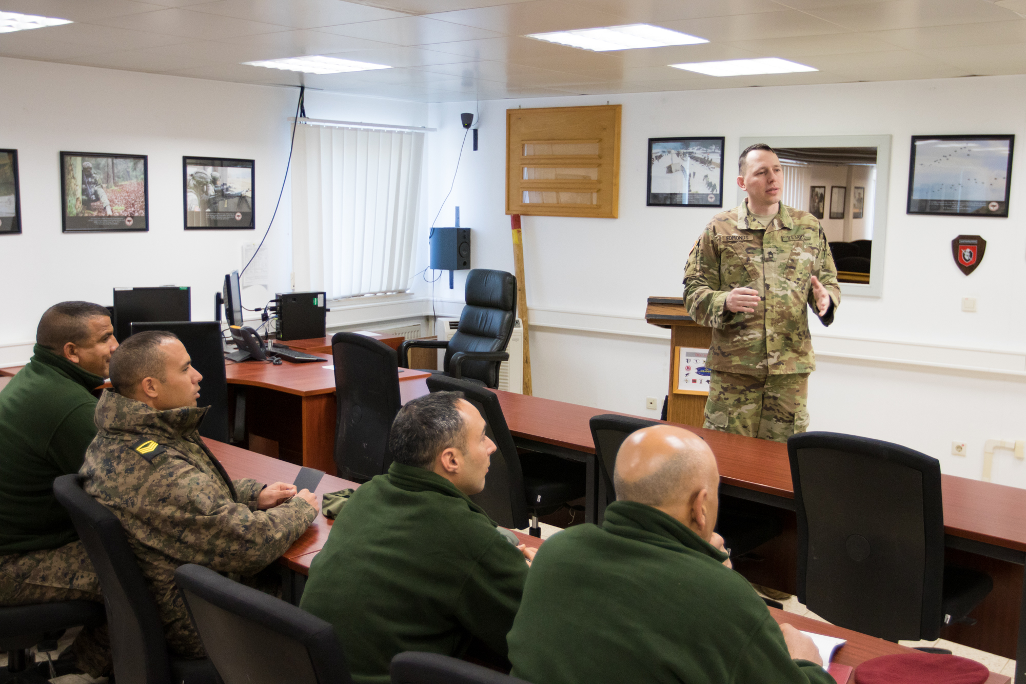 Sgt. First Class Lee Edmonds teaches a group of Tunisian officers and NCOs to be Observer Coach Trainers during Allied Spirit VI at Joint Multinational Readiness Center, Hohenfels Training Area, Germany, March 16, 2017. Allied Spirit VI reinforces the relationships in Europe that have been building during the last 70 years, and provides unsurpassed capability in a strategic and vital location. (Photos by U.S. Army Sgt. William Frye/Released)