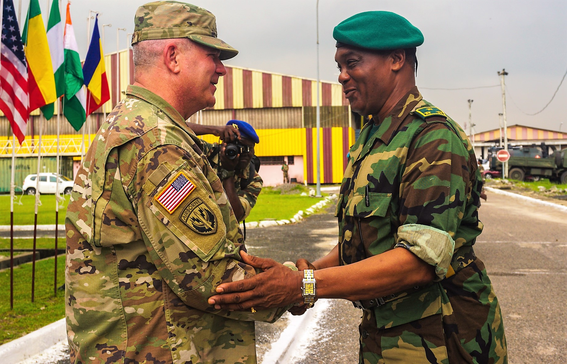 U.S. Army Brig. Gen. Kenneth Moore, U.S. Army Africa deputy commander, greets Cameroonian Maj. Gen. Saly Mohamadou, Commander of the 2nd Military Region of Cameroon, at the opening ceremony for exercise Unified Focus 2017, held on the Douala Naval Base, April 24, 2017. UF 17 is a weeklong tabletop exercise that brings the military partners of the Lake Chad Basin area's Multinational Joint Task Force (MNJTF) together to practice joint planning and coordination through a series of scripted vignettes. (Photo by Capt. Jason Welch, U.S. Army Africa Public Affairs/Released)