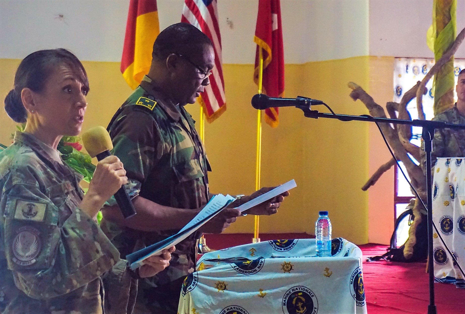 U.S. Air Force Master Sgt. Sarah Balian translates as Cameroonian Maj. Gen. Saly Mohamadou, Commander of the 2nd Military Region of Cameroon, provides his remarks during the opening ceremony for exercise Unified Focus 2017, held on the Douala Naval Base, April 24, 2017. UF 17 is a weeklong tabletop exercise that brings the military partners of the Lake Chad Basin area's Multinational Joint Task Force (MNJTF) together to practice joint planning and coordination through a series of scripted vignettes. (Photo courtesy of U.S. Army Africa Public Affairs/Released)