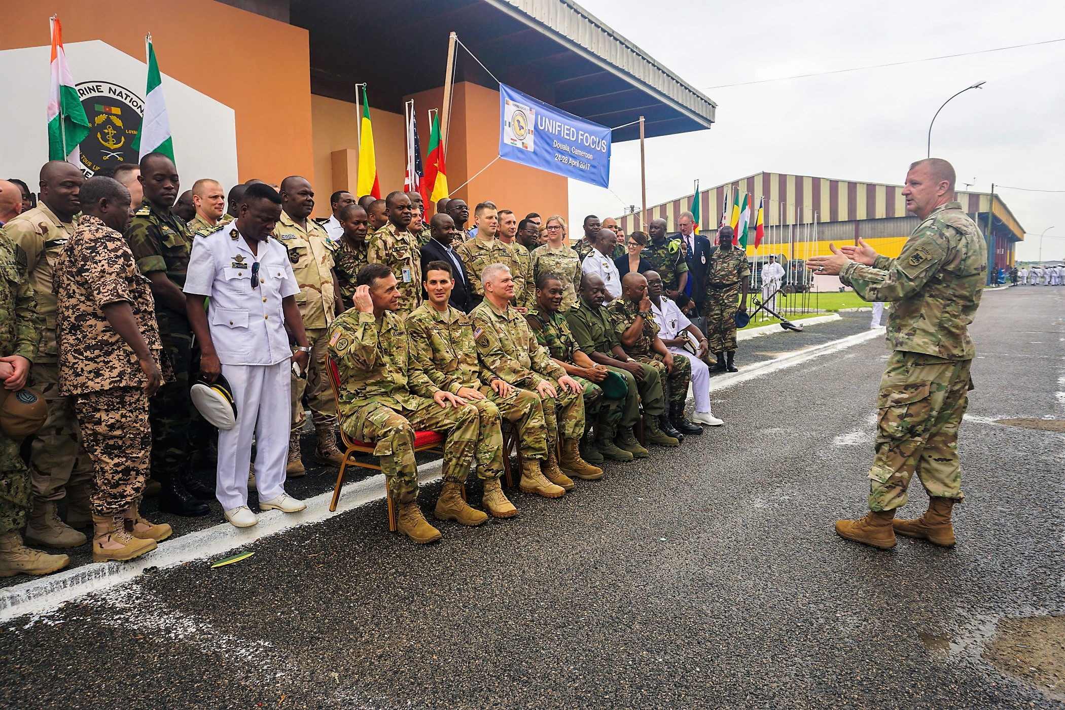 U.S. Army Sgt. Maj. Harold Estabrooks, U.S. Army Africa Army Reserve Engagement Cell, directs the arrangement of the group photo following the opening ceremony for exercise Unified Focus 2017, held on the Douala Naval Base, April 24, 2017. UF 17 is a weeklong tabletop exercise that brings the military partners of the Lake Chad Basin area's Multinational Joint Task Force (MNJTF) together to practice joint planning and coordination through a series of scripted vignettes. (Photo courtesy of U.S. Army Africa Public Affairs/Released)