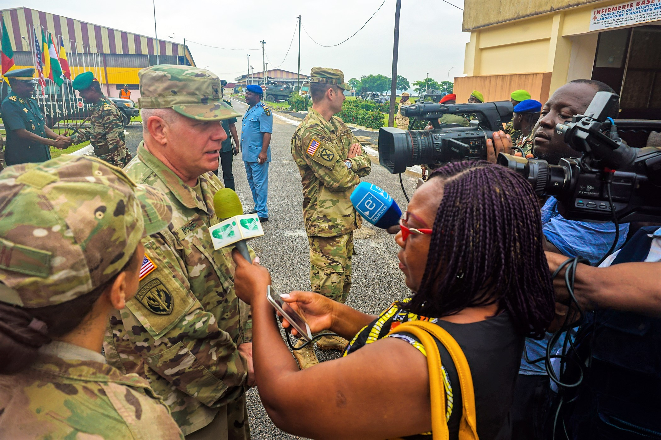 U.S. Army Brig. Gen. Kenneth Moore, U.S. Army Africa deputy commander, answers questions for local journalists following the opening ceremony for exercise Unified Focus 2017, held on the Douala Naval Base, April 24, 2017. UF 17 is a weeklong tabletop exercise that brings the military partners of the Lake Chad Basin area's Multinational Joint Task Force (MNJTF) together to practice joint planning and coordination through a series of scripted vignettes. (Photo courtesy of U.S. Army Africa Public Affairs/Released)