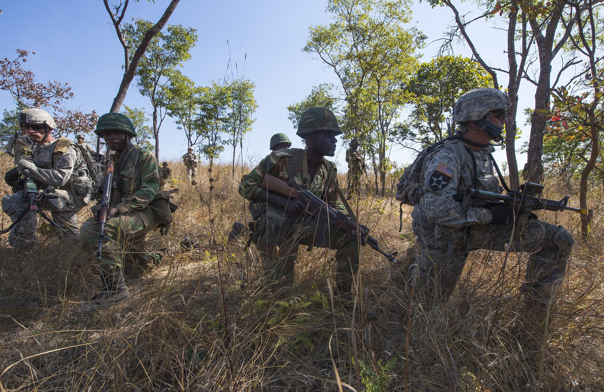 U.S. Army Soldiers and members of the Zambian Defense Force work together during a daytime tactical movement during Exercise Southern Accord 15 in Lusaka, Zambia, Aug. 15, 2015.