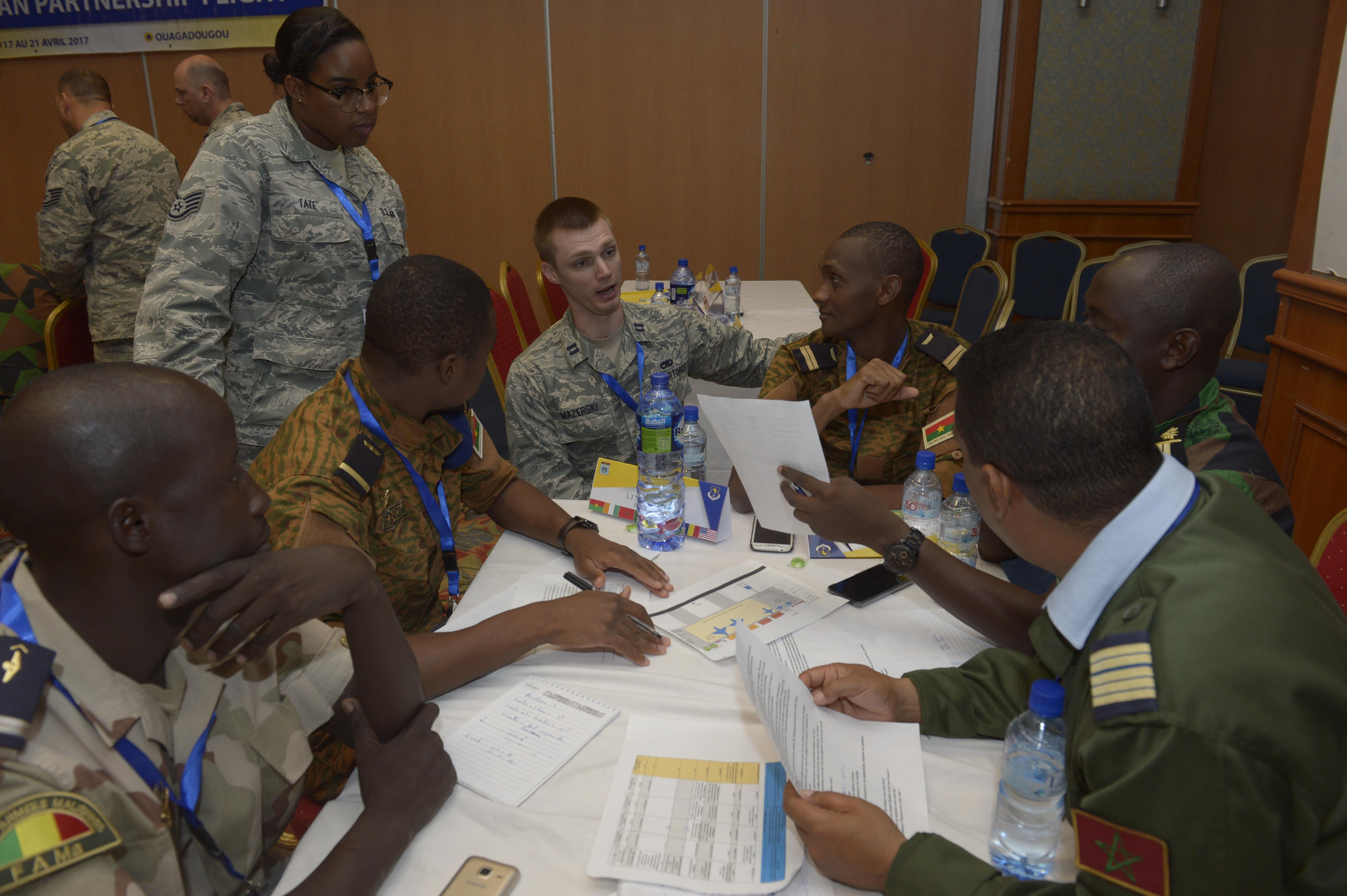 U.S. Air Force Capt. Ian Mazerski, 321st Contingency Response Squadron maintenance flight commander, talks with African Partnership Flight participants during a table top workshop in Ouagadougou, Burkina Faso, April 20, 2017. The intent of APF is to build strong transparent partnerships that enhance regional stability and security through formal alliances, partnerships and simple exchanges of information. (U.S. Air Force photo by Staff Sgt. Jonathan Snyder)