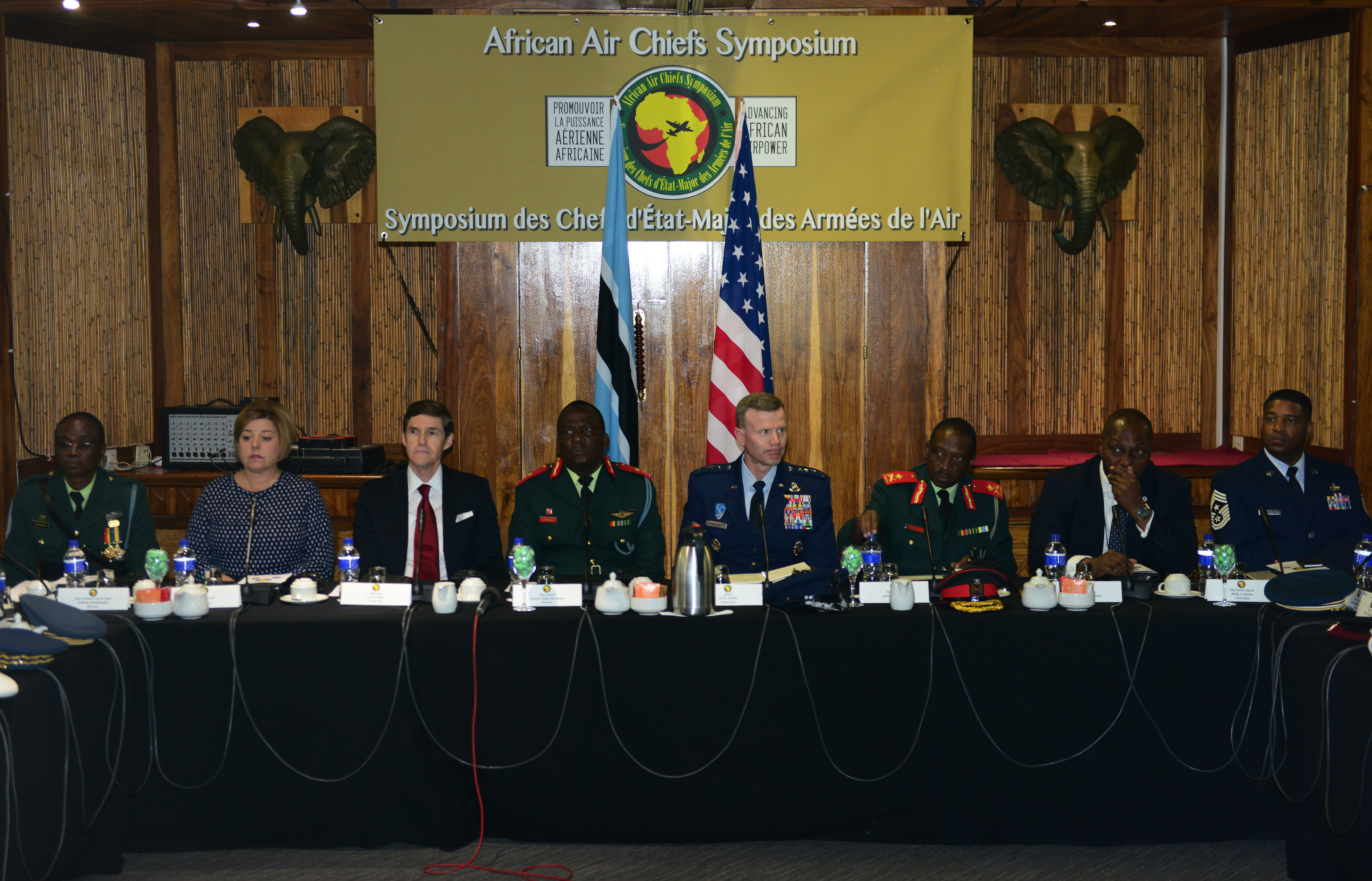 Attendees of the 2017 African Air Chiefs Symposium listen to air chiefs introductions during the opening ceremony in Kasane, Botswana on May 16, 2017. The purpose of the symposium is to create a forum for air chiefs from across the African continent to come together to address regional and continental issues, enhance relationships and increase cooperation. This year's conference will focus on the training aspect of force development. (U.S. Air Force photo by Staff Sgt. Krystal Ardrey/Released)