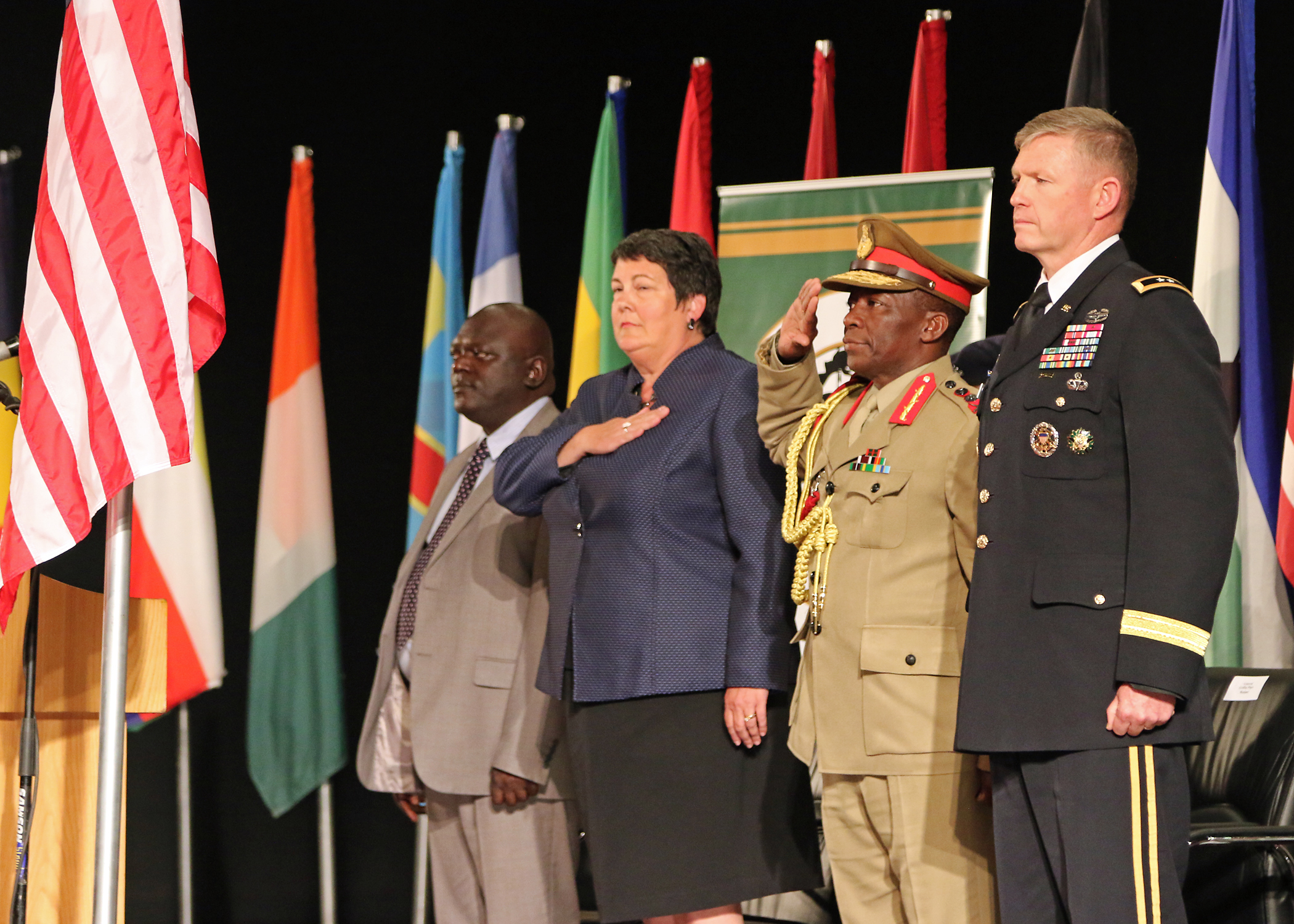 "From left to right: Vincent Ghambi, Deputy Minister of Defense for Malawi, Virginia Palmer, American Ambassador to Malawi, Gen. Griffin ""Spoon"" Phiri, Malawi Defense Force chief of staff, and Maj. Gen. Joseph Harrington, commander of U.S. Army Africa, stand for the Malawi national anthem the closing ceremony of African Land Forces Summit 2017, in Lilongwe, Malawi, May 11, 2017. ALFS is an annual, weeklong seminar bringing together land force chiefs from across Africa for candid dialog to discuss and develop cooperative solutions to regional and transregional challenges and threats. (U.S. Army photo by Sgt. Paige Behringer/Released)"