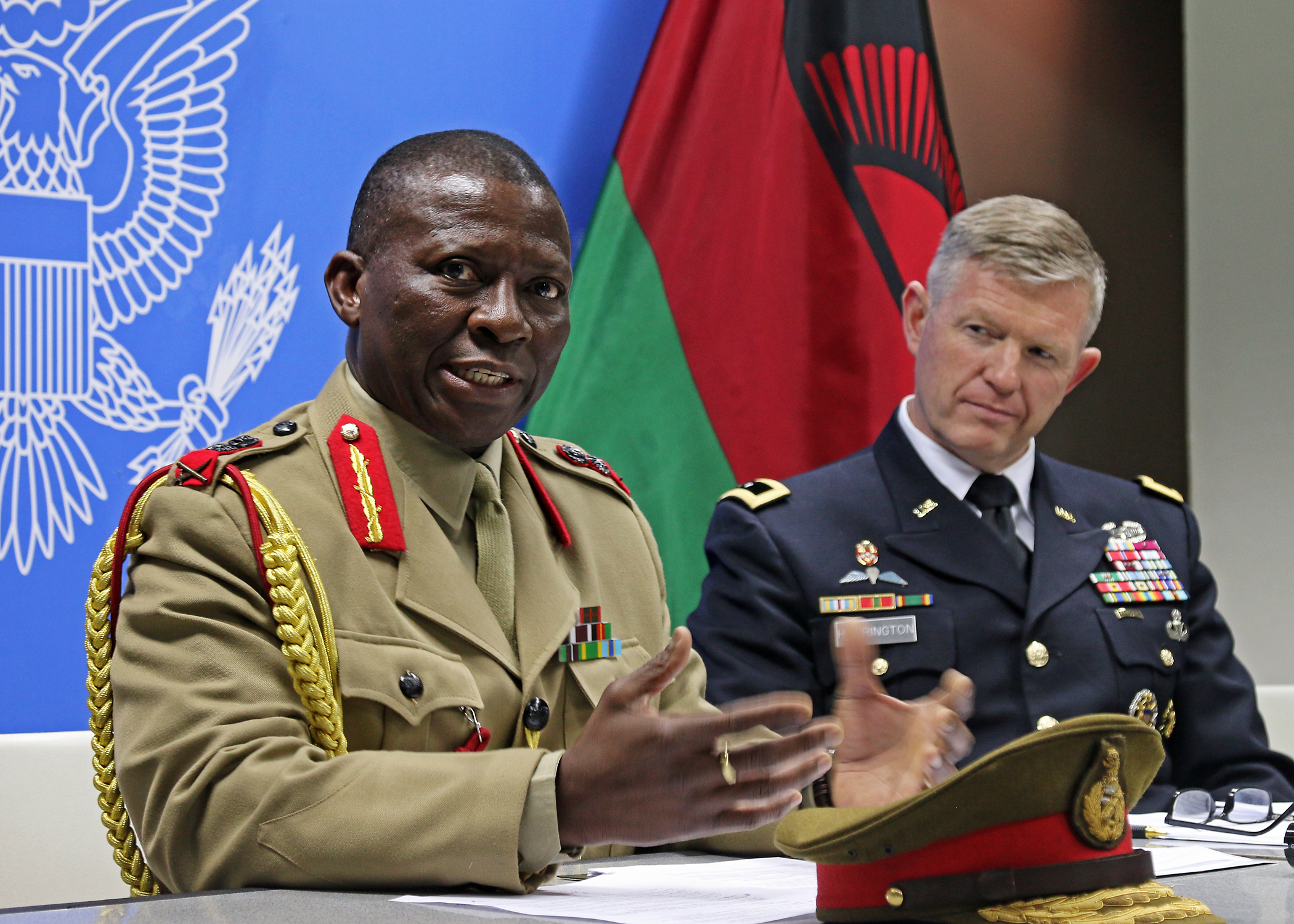 "Gen. Griffin ""Spoon"" Phiri (left), Malawi Defense Force chief of staff, and Maj. Gen. Joseph Harrington, commander of U.S. Army Africa, answer questions during a press conference after the conclusion of African Land Forces Summit 2017, in Lilongwe, Malawi, May 11, 2017. ALFS is an annual, weeklong seminar bringing together land force chiefs from across Africa for candid dialog to discuss and develop cooperative solutions to regional and transregional challenges and threats. (U.S. Army photo by Sgt. Paige Behringer/Released)"