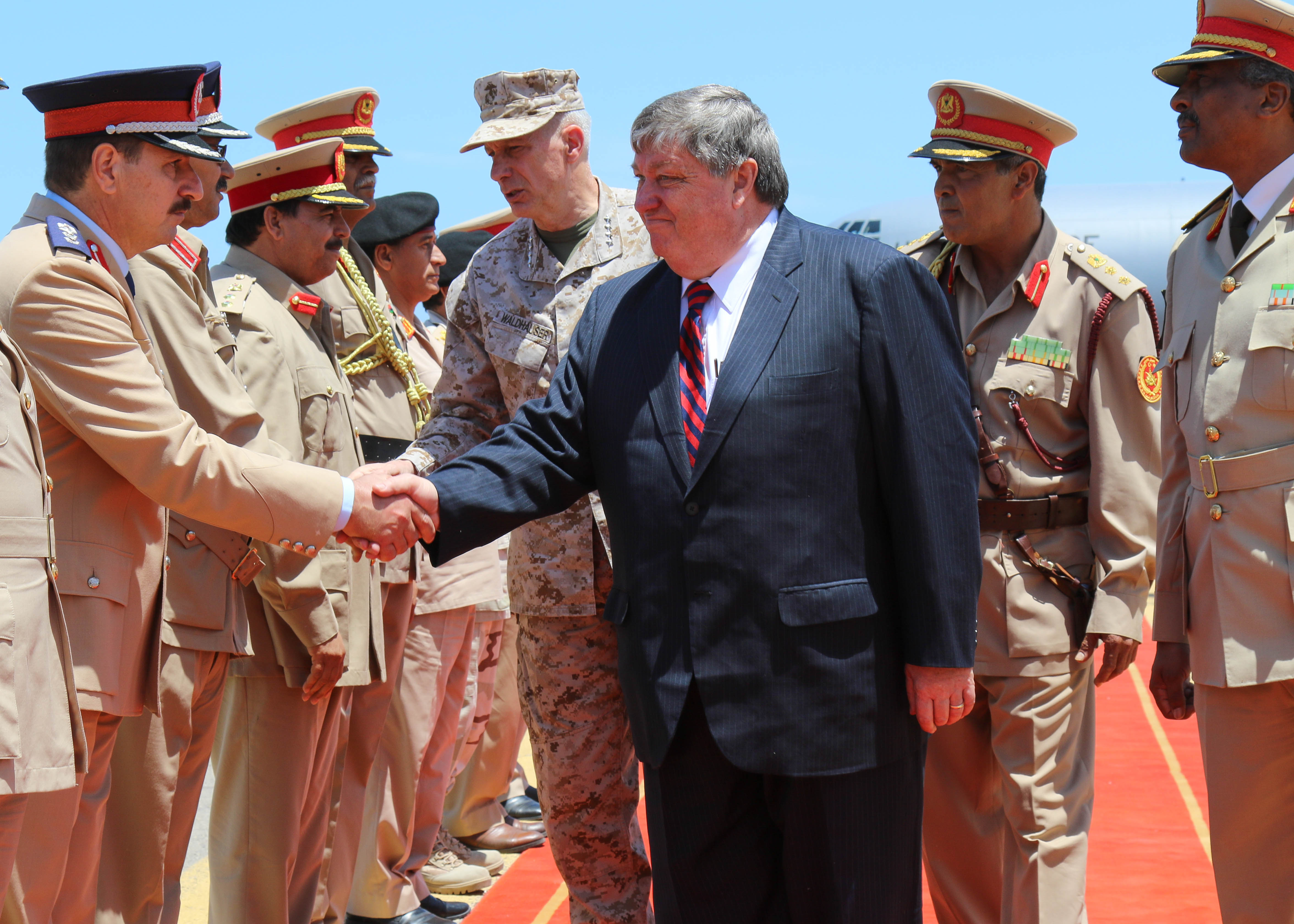 U.S. Marine Corps Gen. Thomas D. Waldhauser, Commander, U.S. Africa Command (USAFRICOM) and Amb. Peter Bodde, U.S. Ambassador to Libya greet members of the Libyan Army during their recent visit to Libya to meet with the Prime Minister of Libya's Unity Government, Fayez al-Sarraj in Tripoli, Libya May 23, 2017. This marks the first time a a high ranking U.S. military official has been in Libya since 2014.