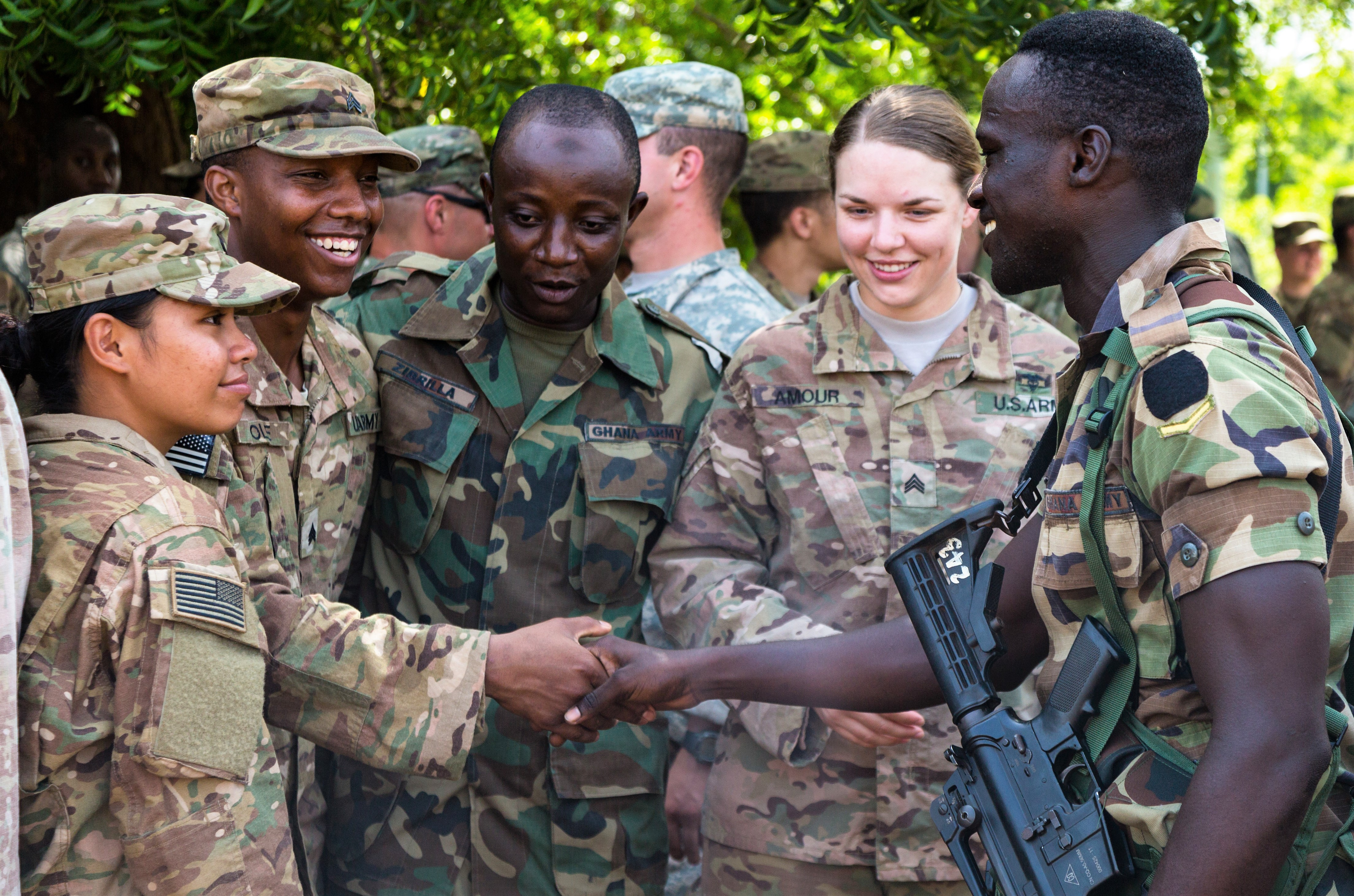 U.S. Soldiers assigned to the 1st Battalion, 506th Infantry Regiment, 1st Brigade Combat Team, 101st Airborne Division and Ghana Armed Forces soldiers participate in a farewell event during United Accord 2017 at Bundase Training Camp, Bundase, Ghana, May 29, 2017. United Accord (formerly Western Accord) 2017 is an annual, combined, joint military exercise that promotes regional relationships, increases capacity, trains U.S. and Western African forces, and encourages cross training and interoperability. (U.S. Army photo by Spc. Victor Perez Vargas/Released)
