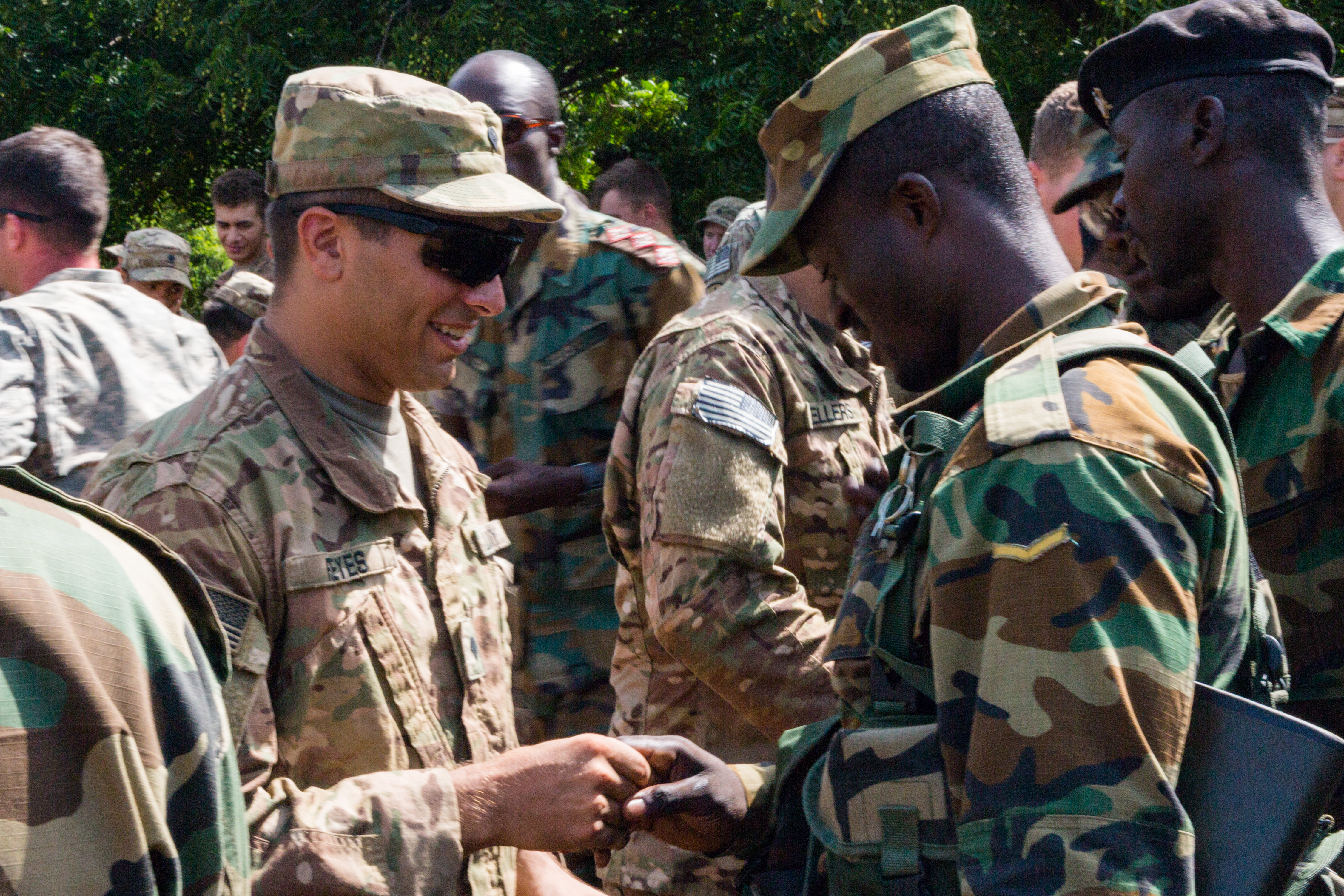U.S. Soldiers assigned to the 1st Battalion, 506th Infantry Regiment, 1st Brigade Combat Team, 101st Airborne Division give their unit patches to Ghana Armed Forces soldiers during United Accord 2017 at Bundase Training Camp, Bundase, Ghana, May 29, 2017. United Accord (formerly Western Accord) 2017 is an annual, combined, joint military exercise that promotes regional relationships, increases capacity, trains U.S. and Western African forces, and encourages cross training and interoperability. (U.S. Army photo by Spc. Victor Perez Vargas/Released)
