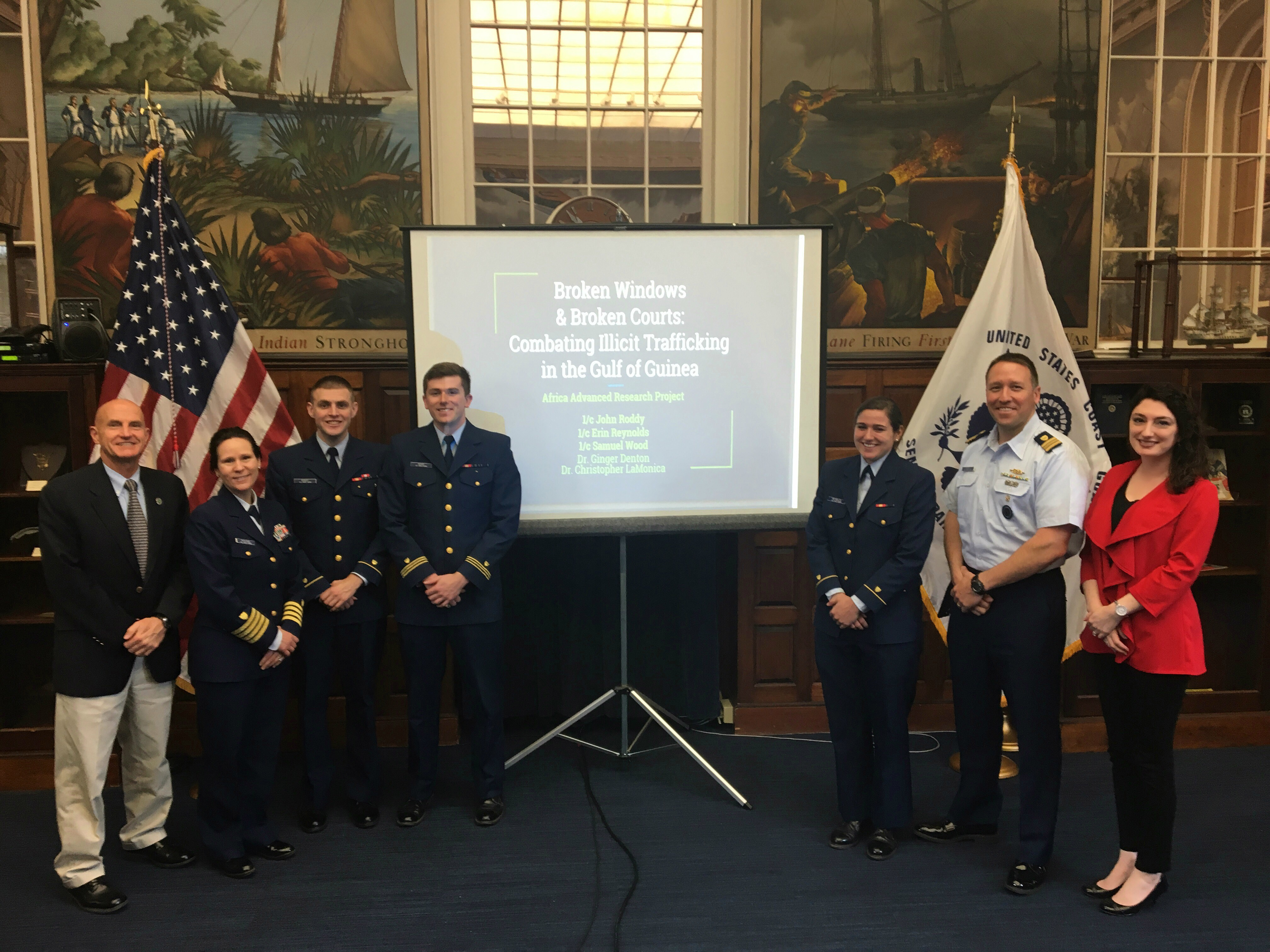 Brian Lisko, U.S. Africa Command Maritime Programs, Capt. Brigid Pavilonis, Chair of the U.S. Coast Guard Academy Department of Humanities, 1st Class Cadet John Roddy, 1st Class Cadet Samuel Wood, 1st Class Cadet Erin Reynolds, Lt. Cmdr. Todd Behney, U.S. Africa Command Maritime Programs, and Dr. Ginger Denton, research team advisor, post for a photo during the U.S. Coast Guard Academy Research Symposium March 27, 2017 at the U.S. Coast Guard Academy
