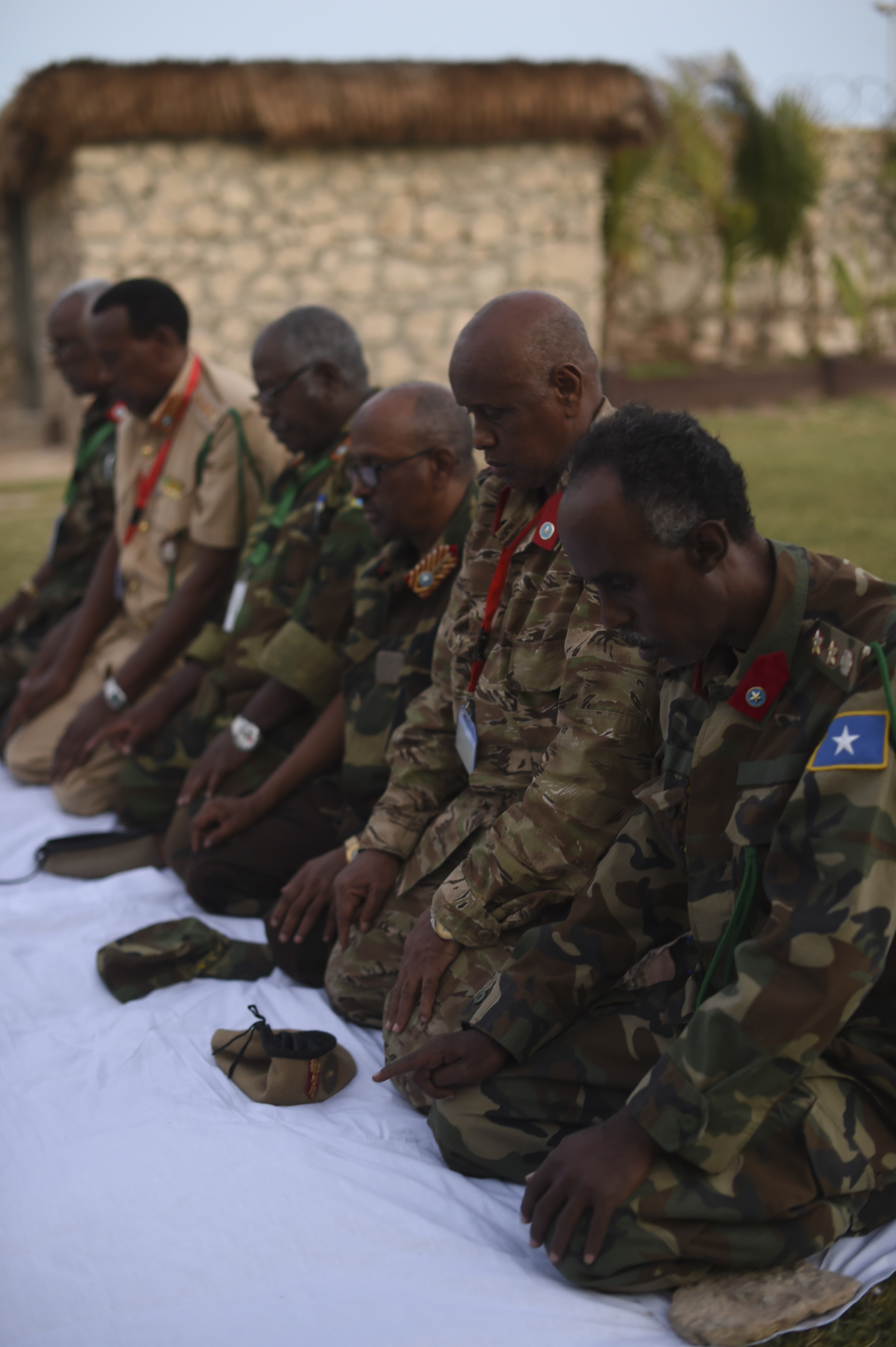 Members of the Somali National Army kneel to pray before an Iftar at the Mogadishu International Airport, Mogadishu, Somalia, June 5, 2017. Iftar is the evening meal when Muslims end their daily Ramadan fast at sunset. (U.S. Air Force Photo by Staff Sgt. Eboni Prince/Released)