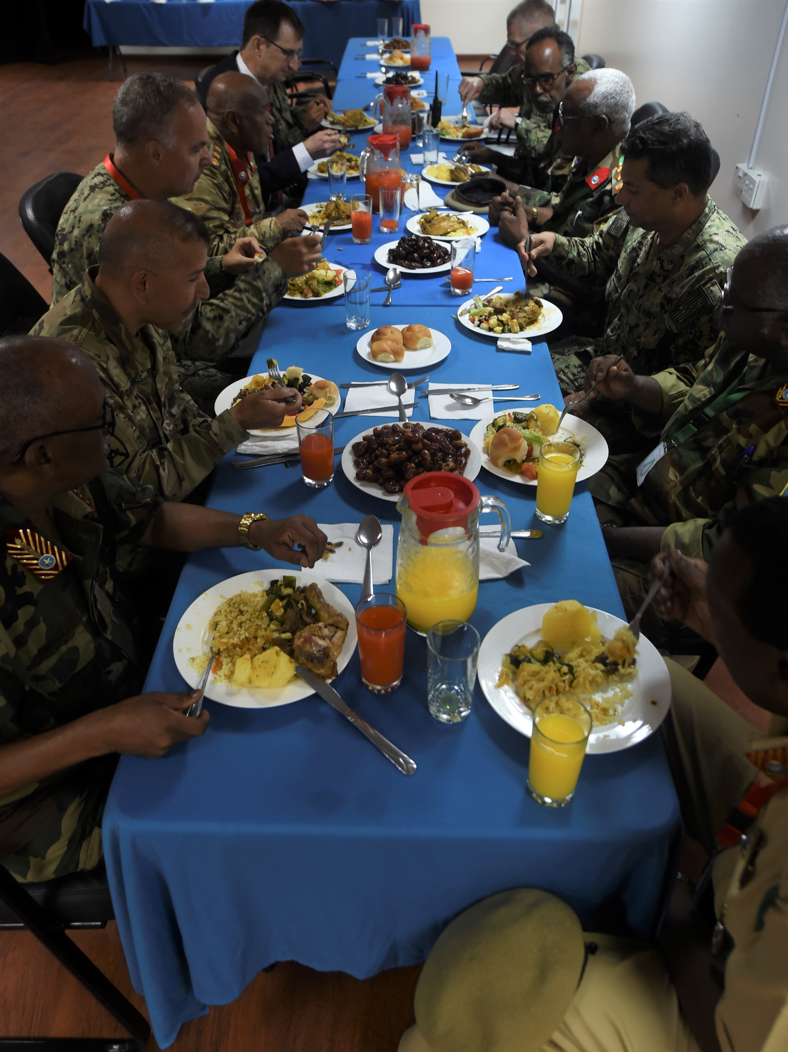 Service members from the U.S. and Somali National Army join for an Iftar, the nightly meal that ends the day's fast during Ramadan, at the Mogadishu International Airport in Mogadishu, Somalia, June 5, 2017. U.S. Army Brig. Gen. Miguel Castellanos, Combined Joint Task Force-Horn of Africa deputy commanding general in Somalia and Mogadishu Coordination Cell director, hosted the Iftar, strengthening bonds between the U.S. and Somali militaries. (U.S. Air Force Photo by Staff Sgt. Eboni Prince/Released)