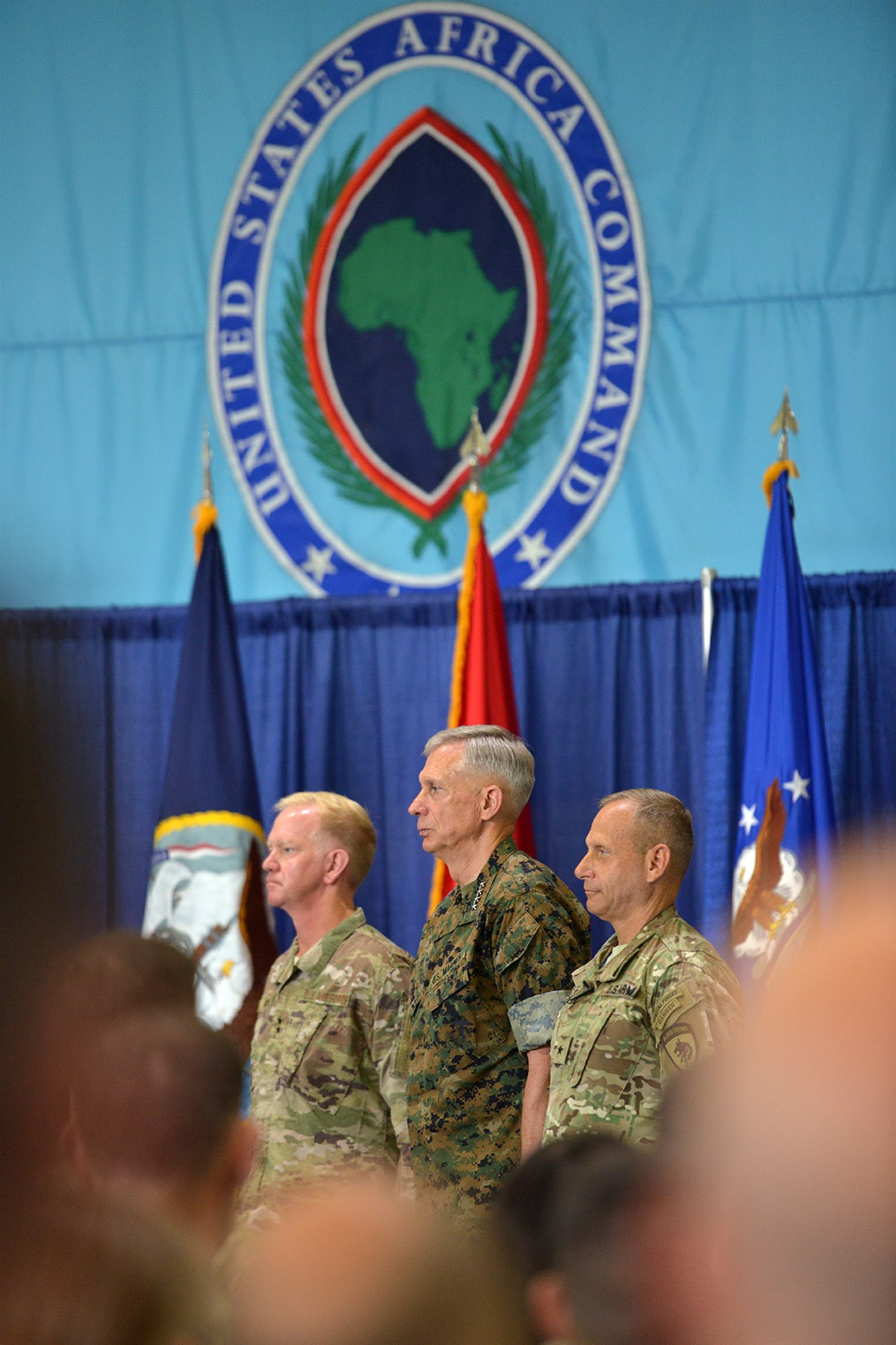 U.S. Marine Corps Gen. Thomas D. Waldhauser, commander of U.S. Africa Command (middle) stands with U.S. Air Force Maj. Gen. J. Marcus Hicks, incoming commander of Special Operations Command Africa (left) and U.S. Army Brig. Gen. Donald C. Bolduc, outgoing commander of Special Operations Command Africa during a change of command ceremony for Special Operations Command Africa at Kelley Barracks, Stuttgart, Germany, June 29, 2017. Special Operations Command Africa supports U.S. Africa Command by counter violent extremist organizations, building the military capacity of key partners in Africa and protecting U.S. personnel and facilities. (U.S. Army photo by Visual Information Specialist Jason Johnston.)